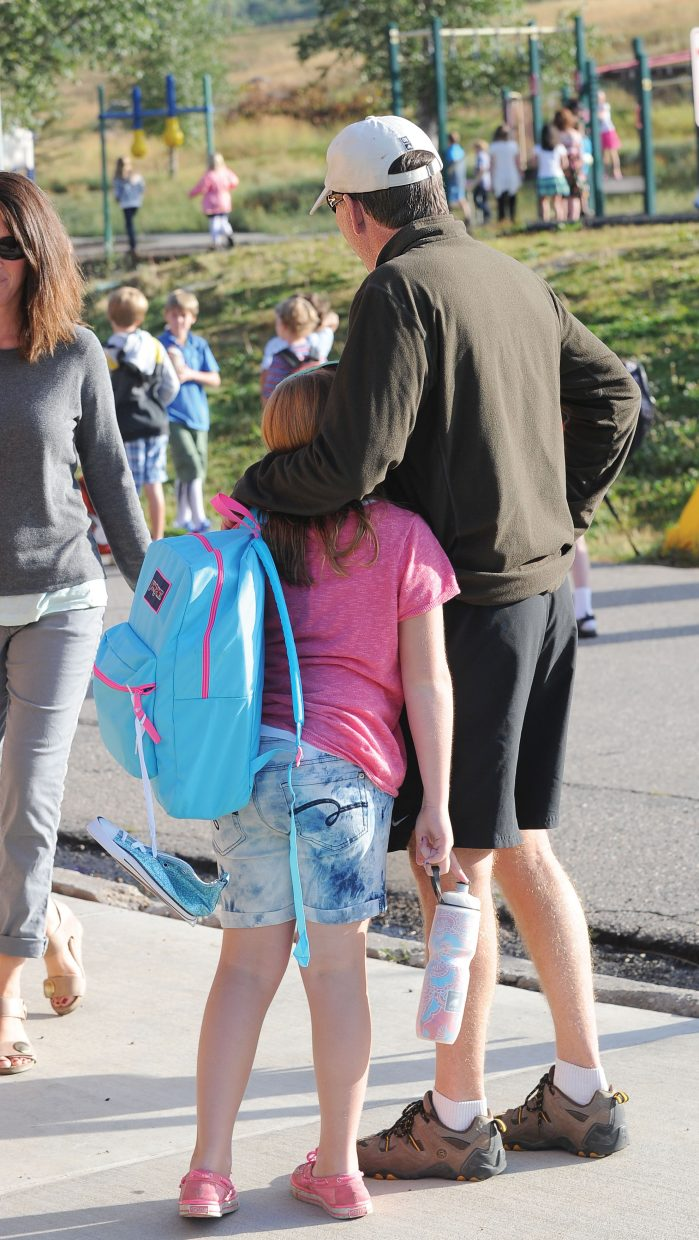 John Dickson hugs his daughter Elise on her first day at Strawberry Park Elementary School. The family recently moved into the district, and it was Elise's first day of school in Steamboat.
