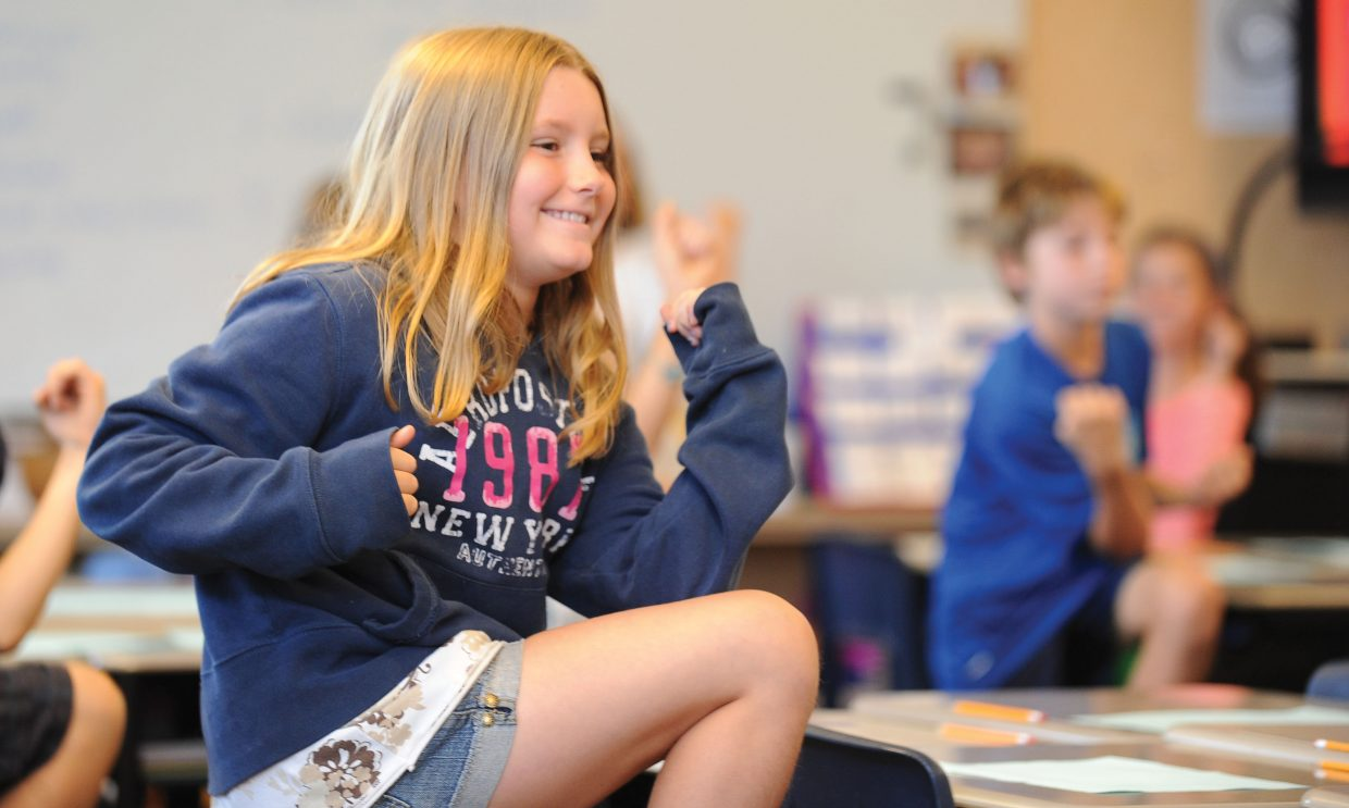 Laken Wiese runs through a series of exercises designed to get the blood flowing before getting down to work in Cecily Townsend's fourth-grade class on the first day of school Wednesday at Soda Creek Elementary School in Steamboat Springs.