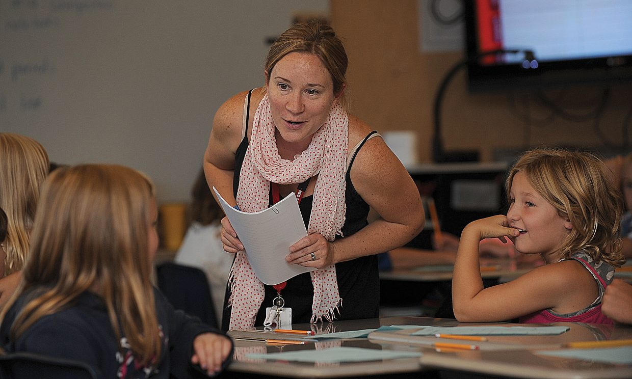 Cecily Townsend talks with students on the first day of classes at Soda Creek Elementary School.