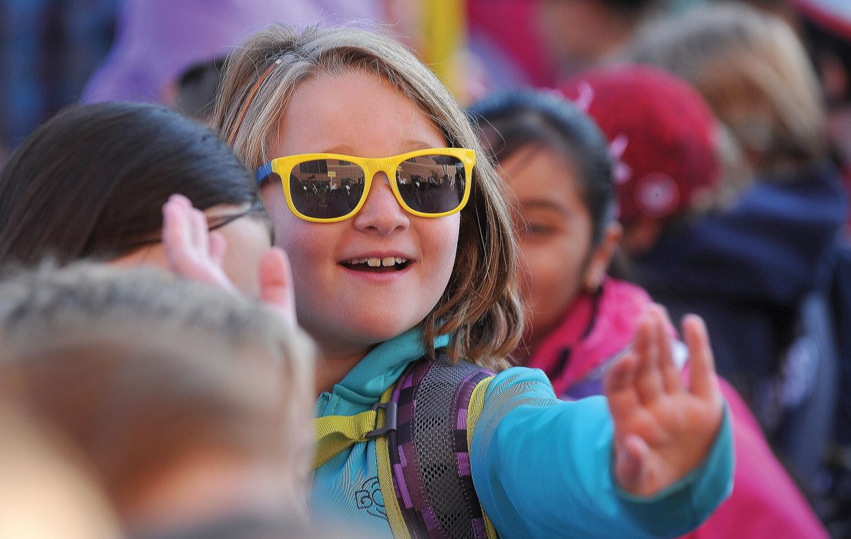 Soda Creek Elementary School third-grader Liv Mason waves goodbye to her parents — and goodbye to summer — as children at Soda Creek and other campuses in the Steamboat Springs School District headed back to class Wednesday morning.