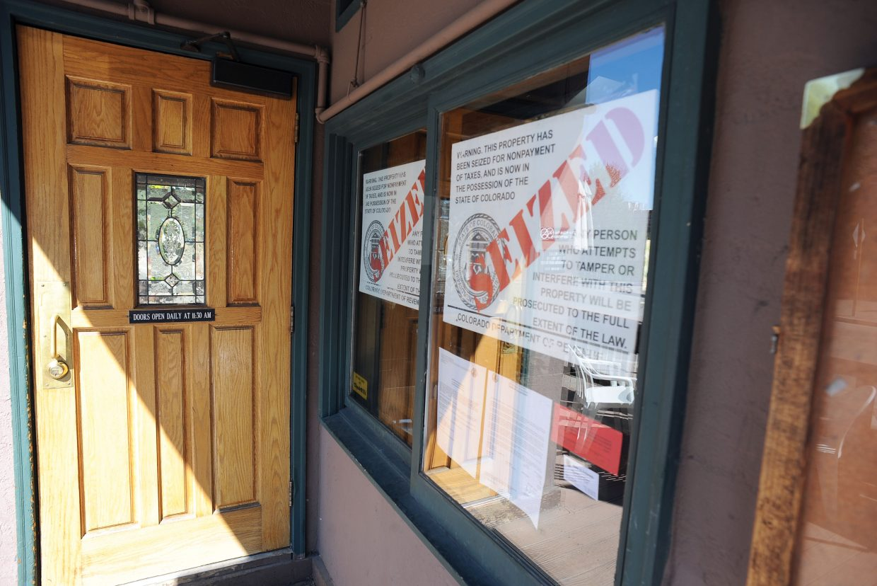 The Tugboat Grill & Pub is set to have its contents auctioned if the owners can't come up with more than $10,000 in taxes and penalties by Sept. 11.