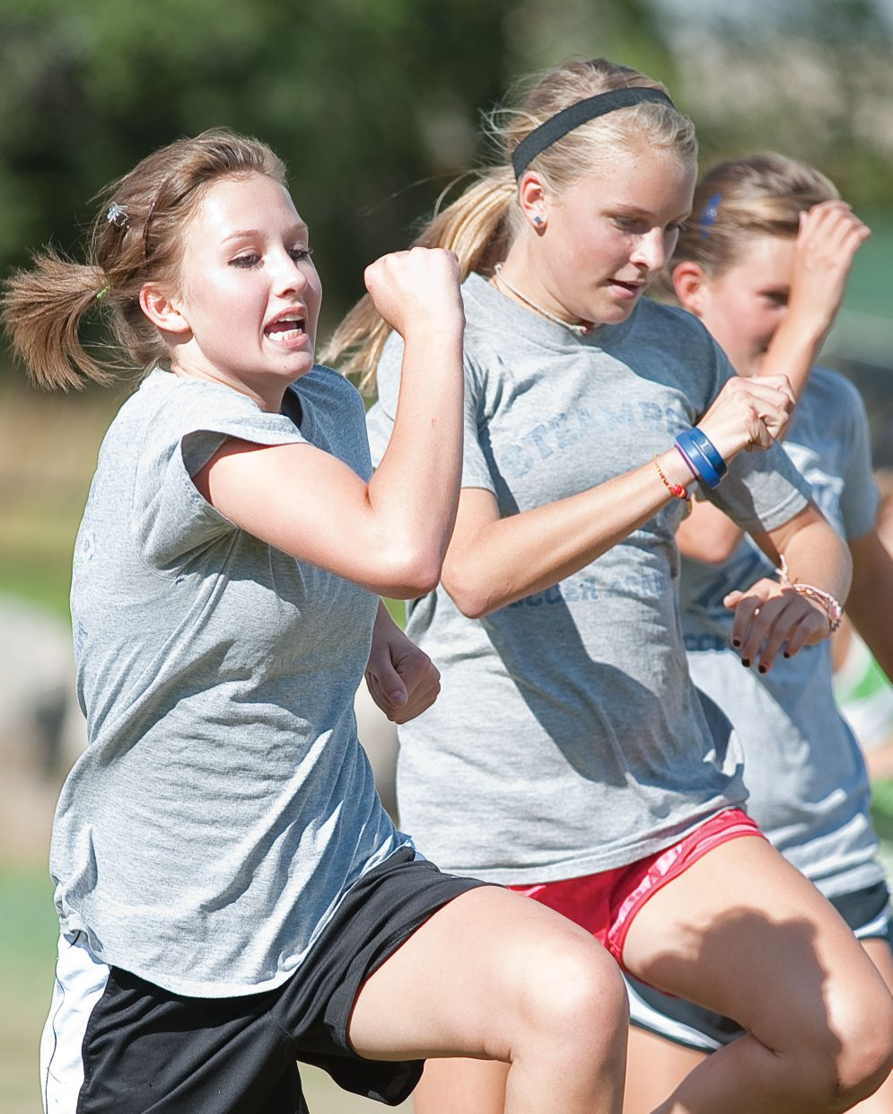 Sophomore Lena Barker warms up with her teammates on the Steamboat Springs High School cross-country team prior to a training run this week at Emerald Park.