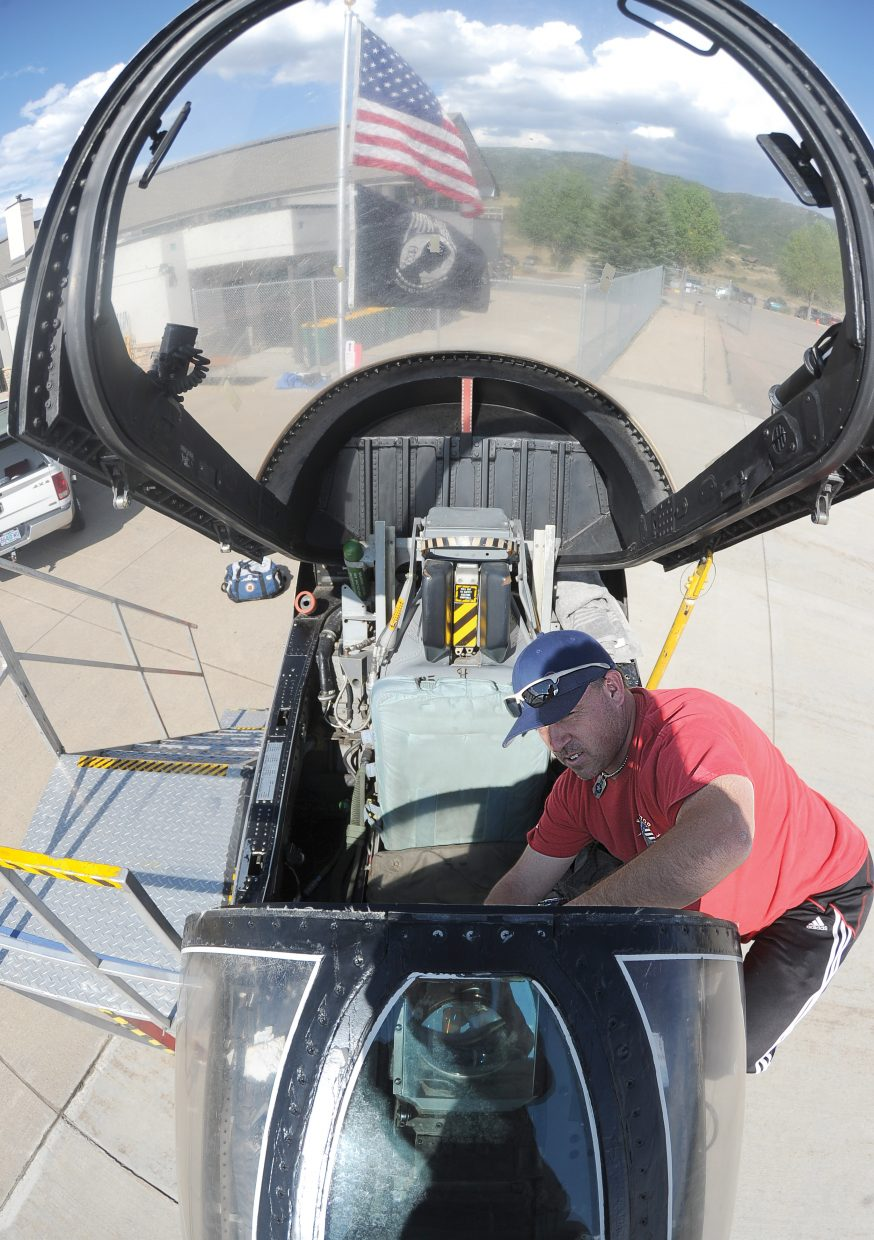 Dewey Larson, with Big Dream Entertainment, sets up the cockpit of an A-7 Corsair II. The plane was built for the U.S. Air Force and used during the Vietnam War and Operation Desert Storm. Larson now transports a section of the fighter jet to air shows and other events where he offers history lessons, tours and the chance to slip into a flight suit and sit in the cockpit. His display will be part of this year's Wild West Air Fest, which takes place from 9 a.m. to 3 p.m. Saturday and Sunday at Steamboat Springs Airport. The cost to attend the event is $6 for adults, $3 for youths ages 6 to 12 and free for children younger than 6.