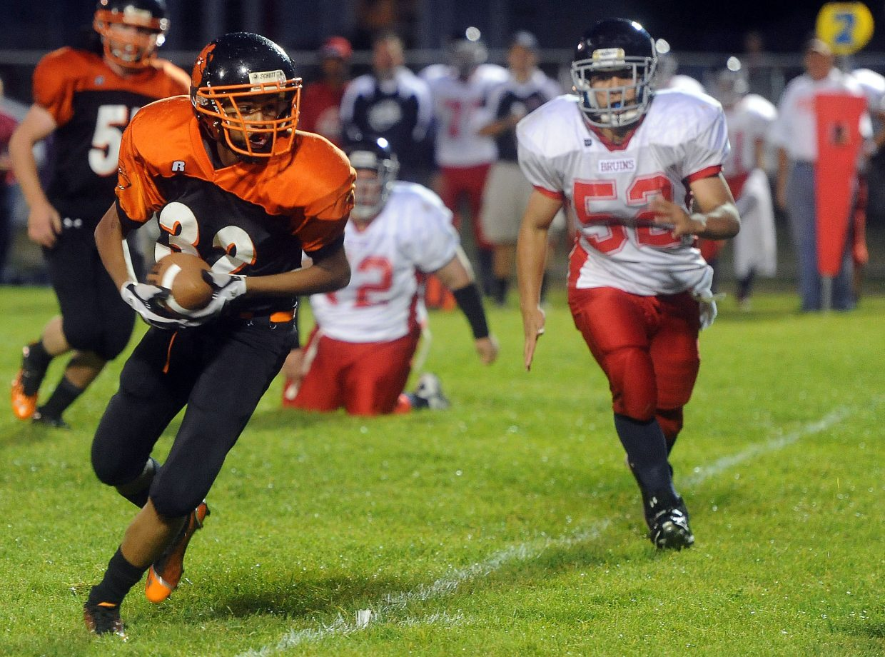 Hayden's Jack Redmond turns up the field with the ball Friday.