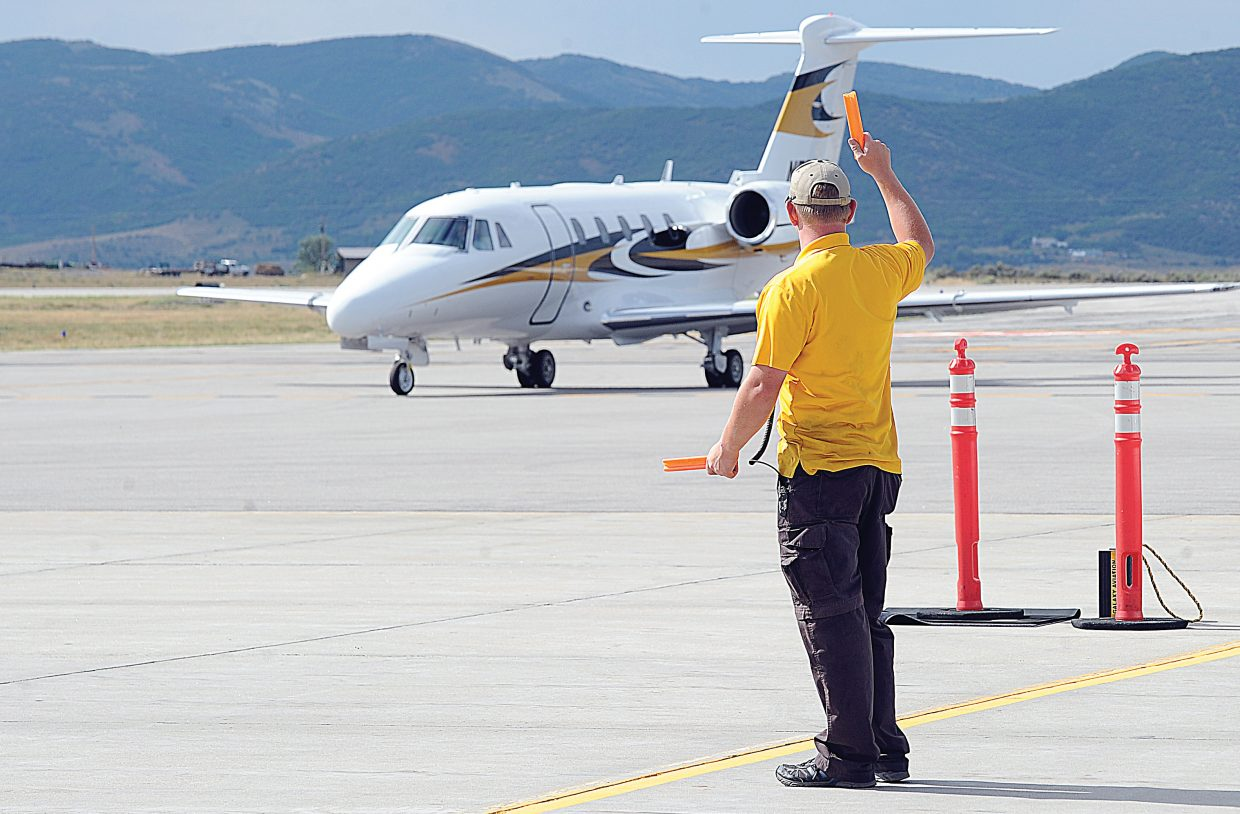 Aaron Hornstein, who works for Galaxy Aviation in Hayden, parks a jet as it arrives at the Yampa Valley Regional Airport. A runway resurfacing project at YVRA will shut the airport down for 55 to 60 days in the spring.