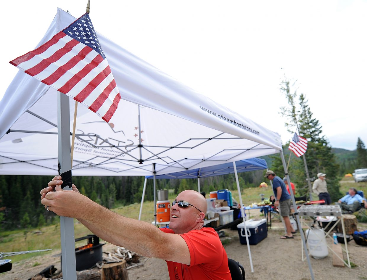 Steamboat Adaptive Recreational Sports' Craig Kennedy tapes up a flag at the camping site for a night at Hahn's Peak Lake. STARS played host to its second veterans-only camp last month. The local organization has found success raising money for veterans camps, and those events have helped turn donations toward the group's more general programming.