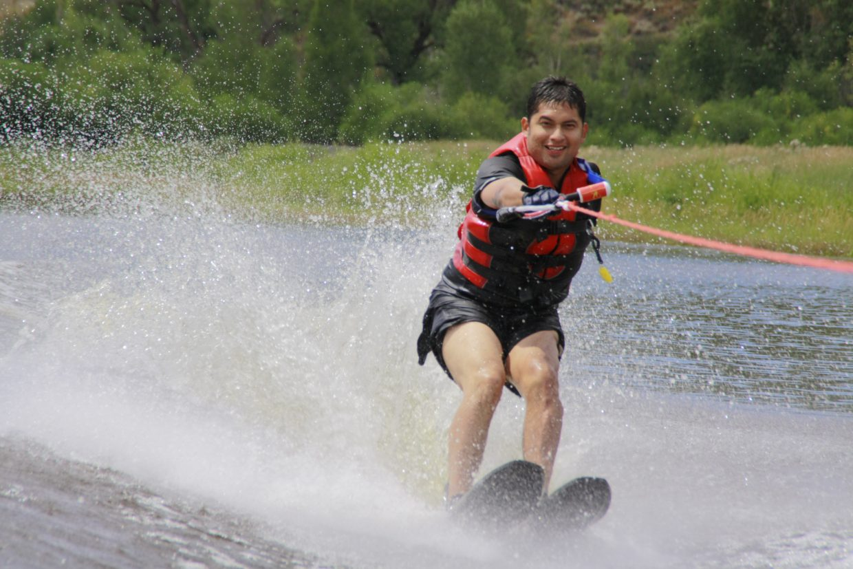 Dan Acosta, a veteran from Chicago at his second Steamboat-area camp, waterskis last month during the STARS and Stripes Heroes Camp near Steamboat Springs.