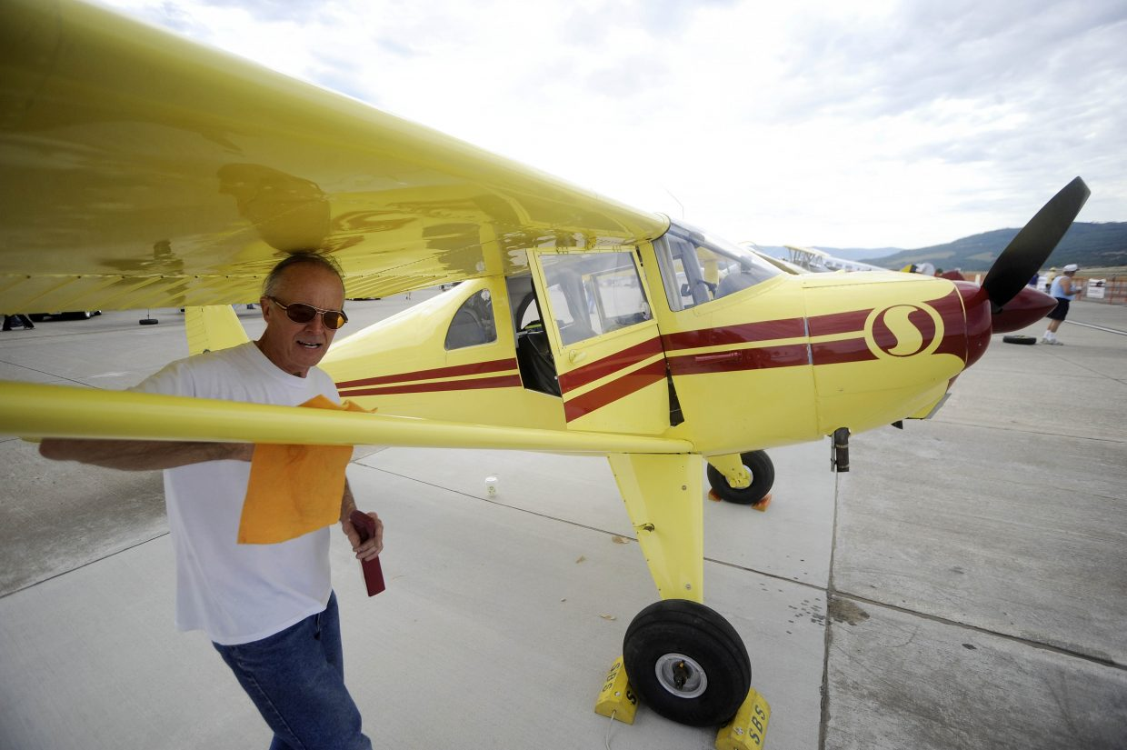Durango resident Rob Flannery polishes his 1947 Luscombe on Saturday during the Wild West Air Fest at Steamboat Springs Airport.