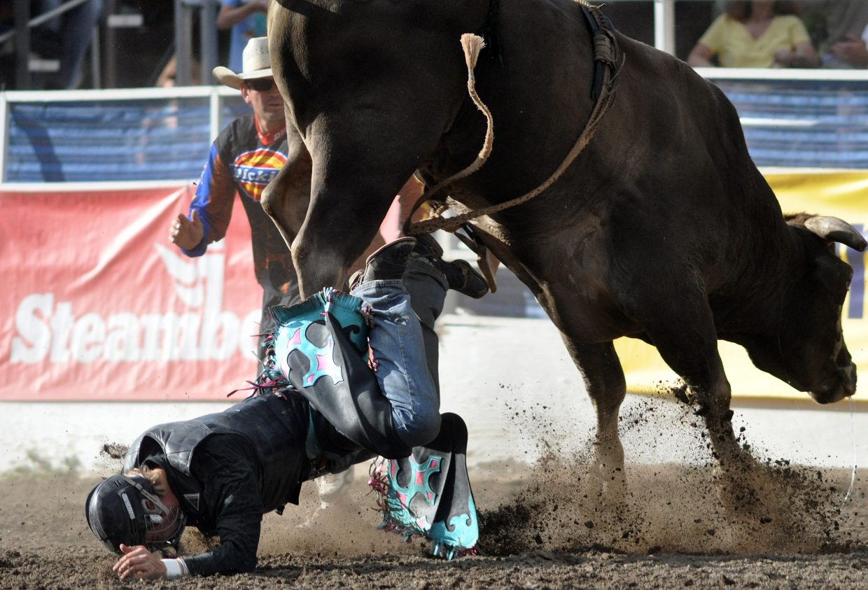 Brice Osborn, of Rifle, takes a hard fall after a short ride on Fighter on Sunday at the Rocky Mountain Bull Bash.
