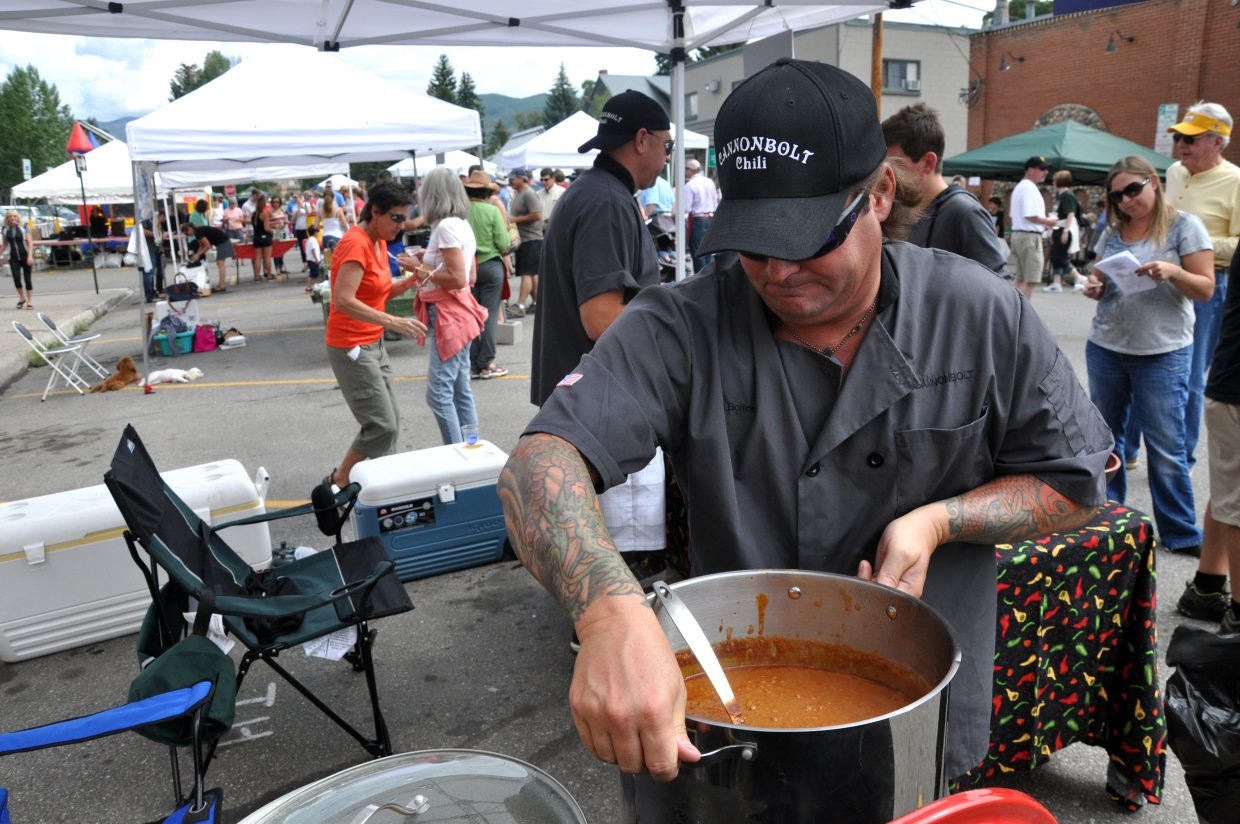 Sam Bolton prepares to dish up another pot of chili on Sunday at the Chuck Wagon Chil Challenge in downtown Steamboat Springs.