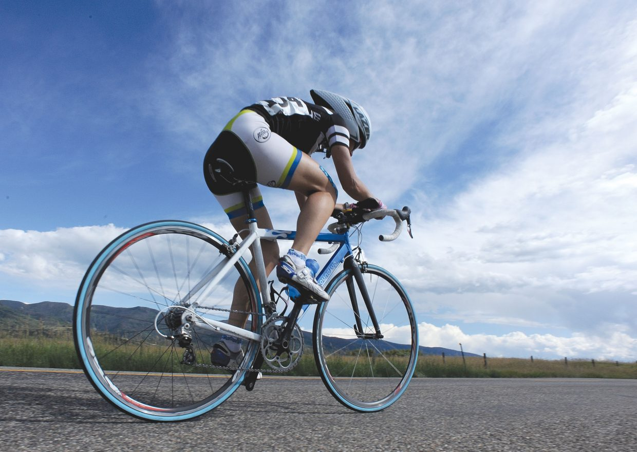 Catherine Johnson, of Boulder, races along River Road on Friday afternoon during the time trial of the Steamboat Springs Stage Race. The event kicked off Friday and continues through Monday.