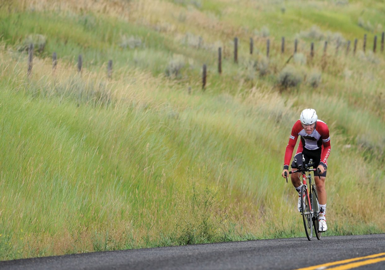 Steamboat Springs cyclist Sam Chovan makes his way up a hill along Routt County Road 14 during the time trial Friday. The race was the first event in the Steamboat Springs Stage Race.