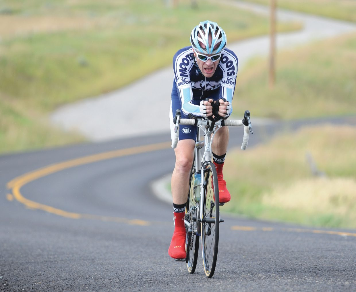 Steamboat Springs cyclist Jon Cariveau races along Routt County Road 14 on Friday afternoon during the time trial of the Steamboat Springs Stage Race.