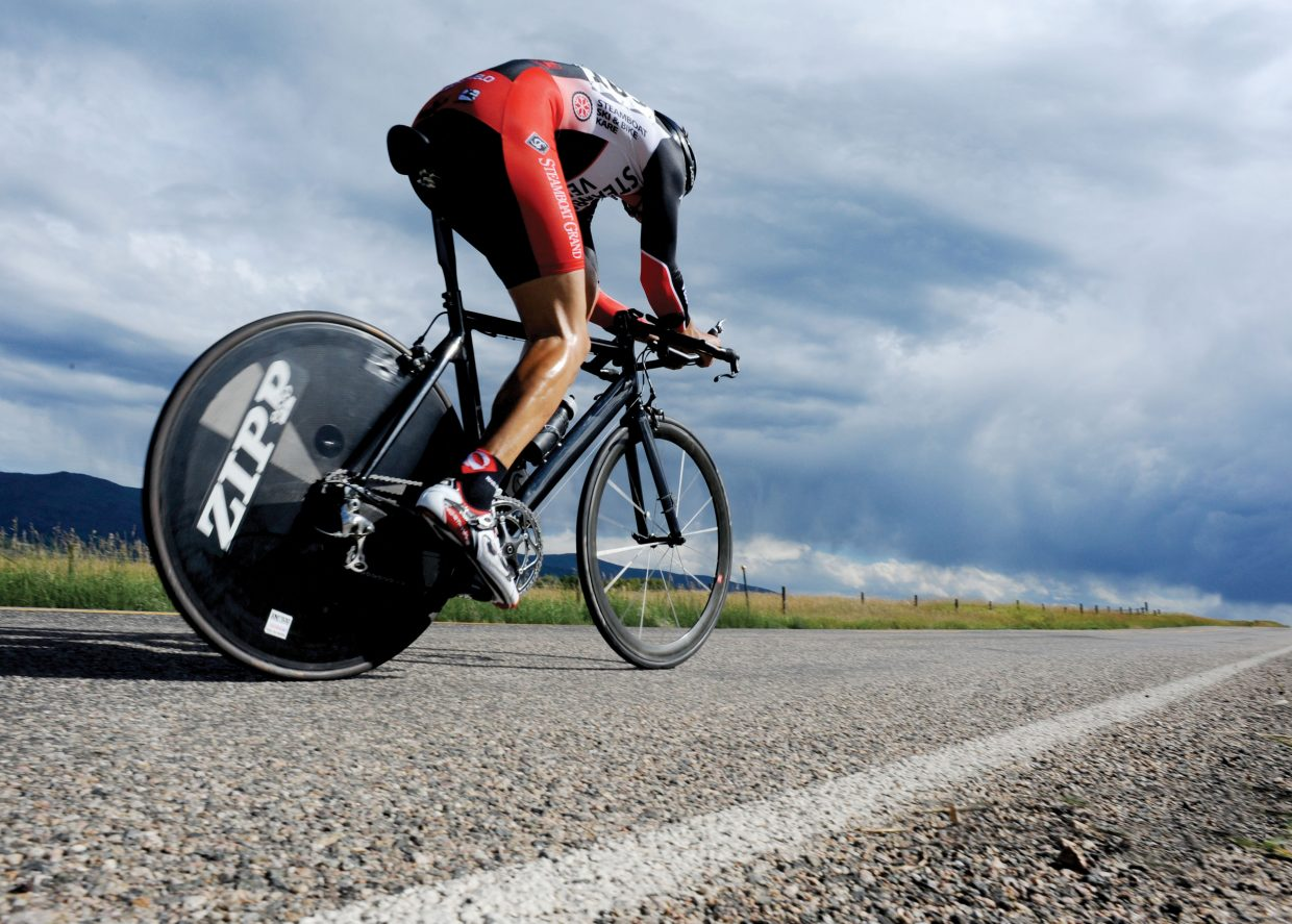 Steamboat Springs cyclist Matthew Charity races down Routt County Road 14 on Friday afternoon during the time trial, the first stage of the Steamboat Springs Stage Race.
