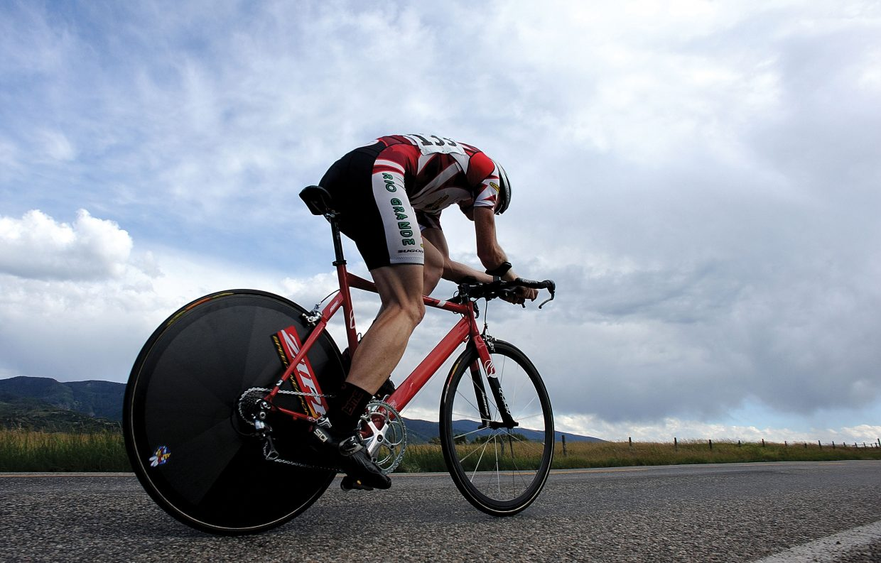 Steamboat Springs cyclist Barkley Robinson races down Routt County Road 14 on Friday afternoon during the time trial, the first stage of the Steamboat Springs Stage Race.