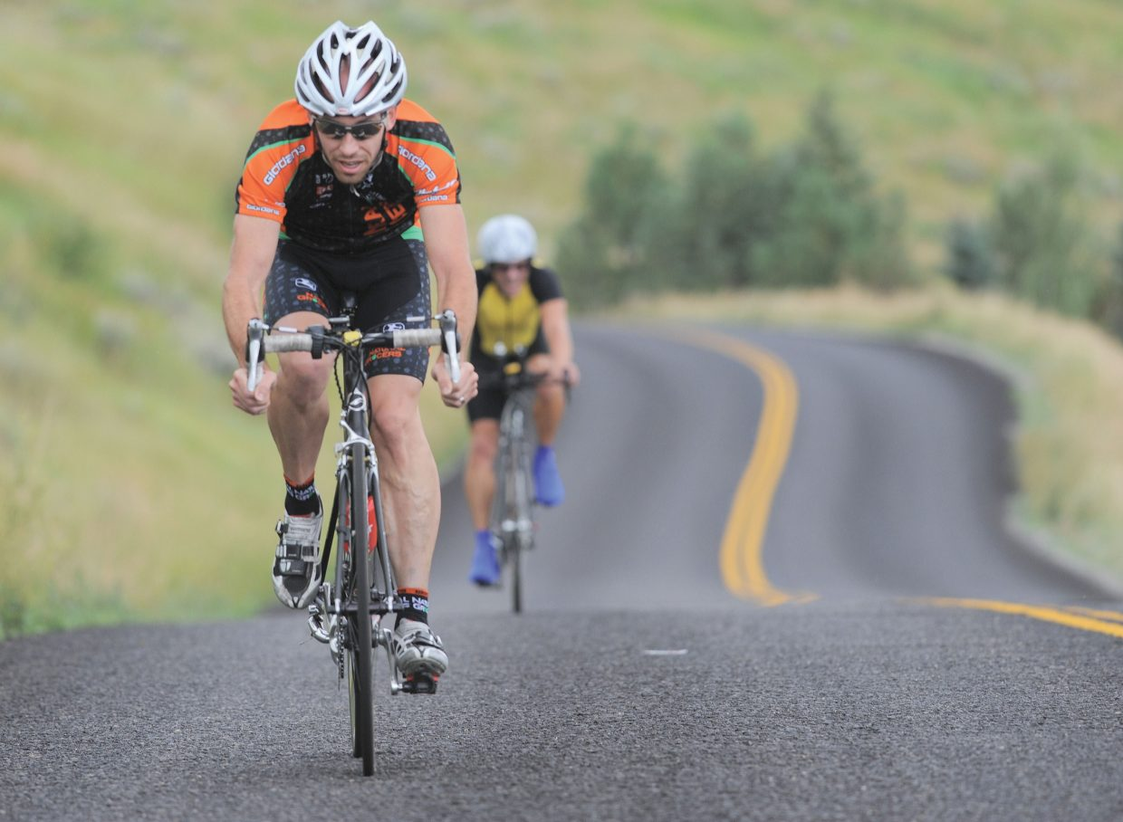 Fort Collins cyclist Rich Nibbe races along Routt County Road 14 on Friday afternoon during the time trial, the first stage of the 2011 Steamboat Springs Stage Race. The event will continue through the weekend coming to a conclusion with stage four on Monday.