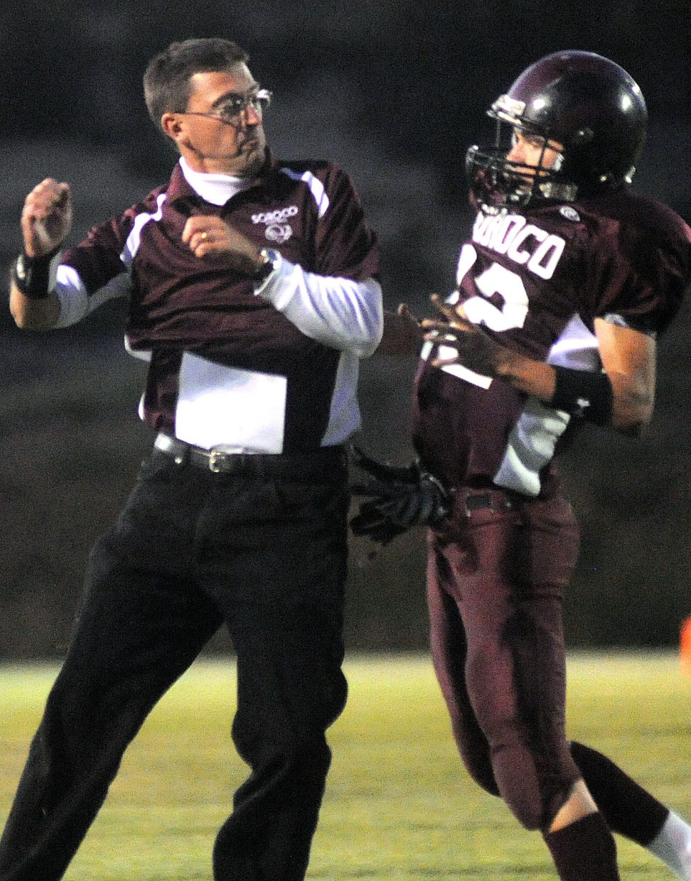 Soroco coach David Bruner and junior quarterback Nic Paxton leap to celebrate Soroco's first touchdown of the season Friday as the Rams rolled over Nucla, 44-18.