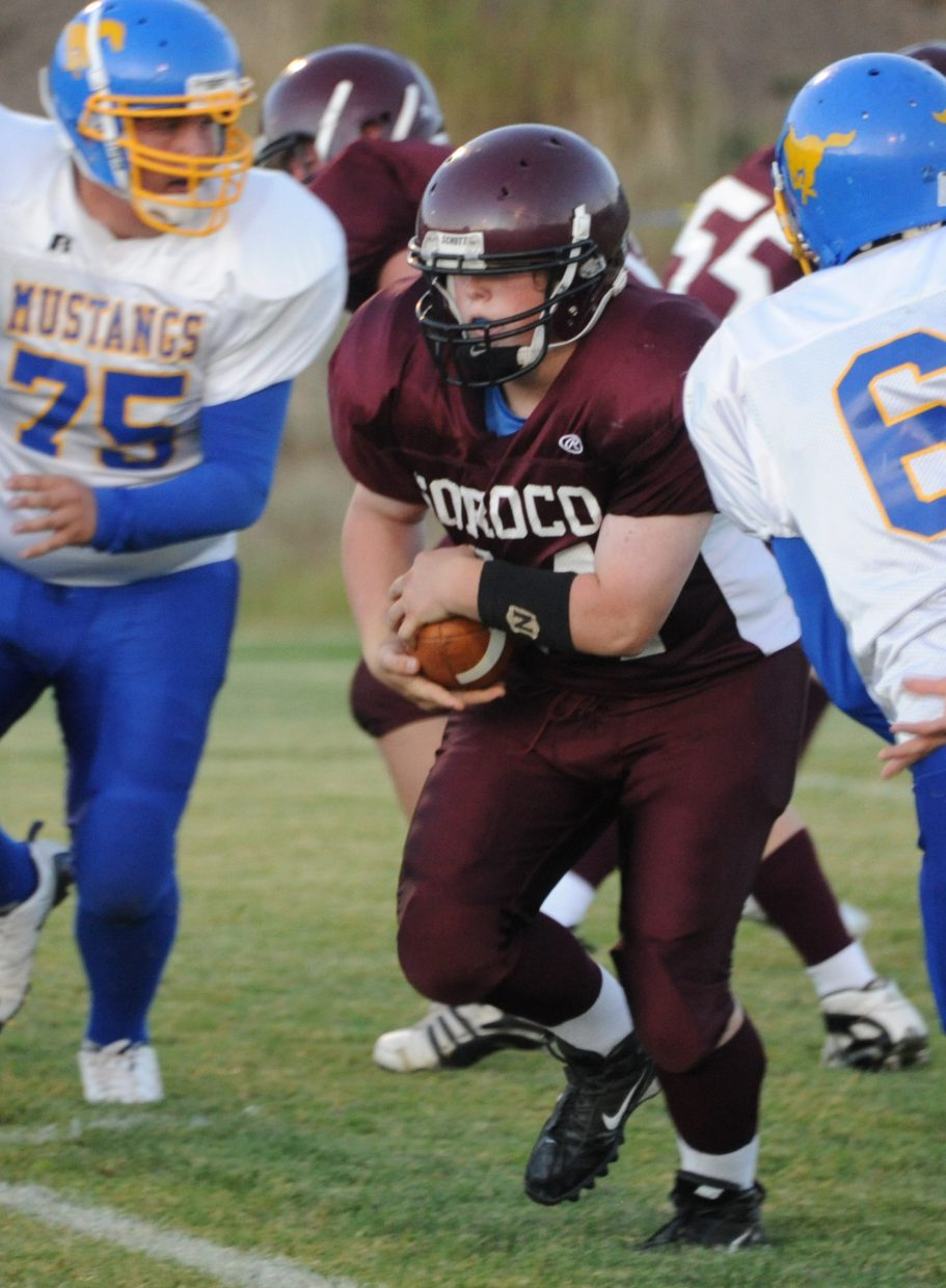 Soroco's Ian Palyo charges through the line Friday as the Rams played Nucla.