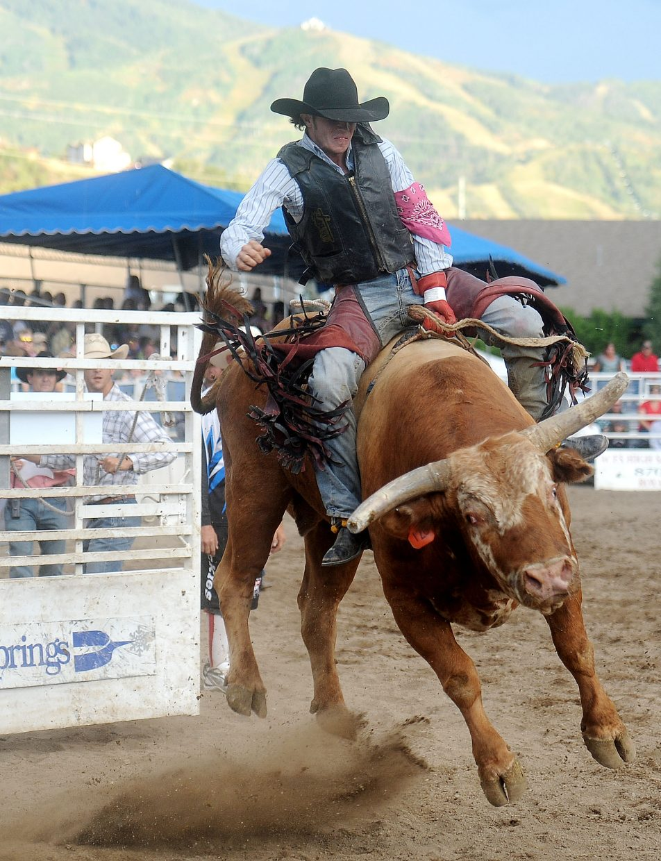 Idaho bull rider Kody DeShon hangs on to his beast Sunday during the PBR Rocky Mountain Bull Bash in Steamboat Springs. DeShon made the eight seconds to win the event.