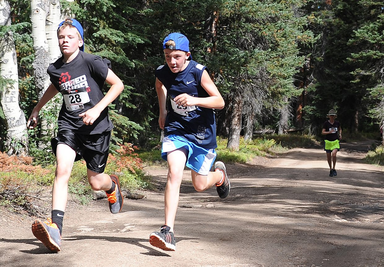Caleb Linscombe, left, and Kyle Mace race toward the finish line during the 5-kilometer race at Sunday's 10K at 10,000 Feet on Rabbit Ears Pass.