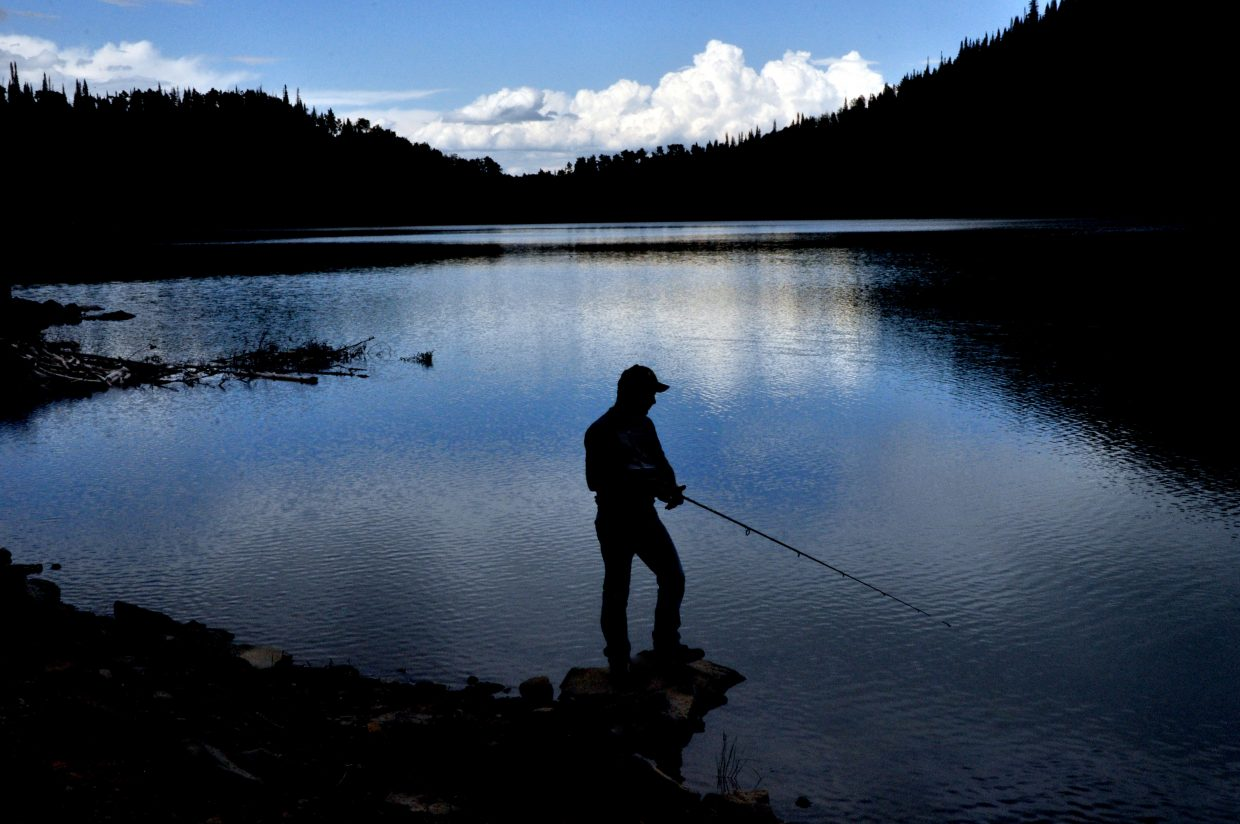 Victor Colaleo, of Idaho Springs, fishes for trout in the calm waters of Crosho Lake in South Routt County.