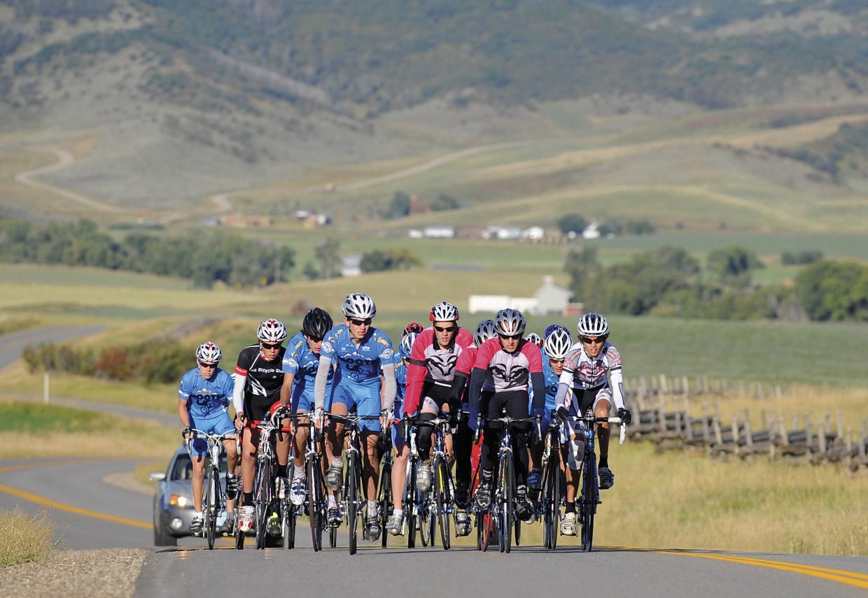The junior division, including members of the Steamboat Springs Winter Sports Club's elite cycling program wearing blue Moots jerseys, starts Saturday's race at Marabou Ranch as part of the Steamboat Springs Stage Race.