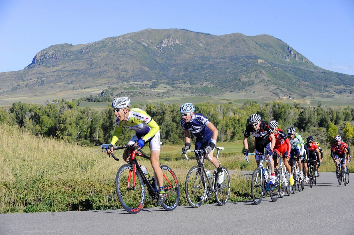 Racers climb a hill Saturday during the second stage of the second annual Steamboat Springs Stage Race at Marabou Ranch.
