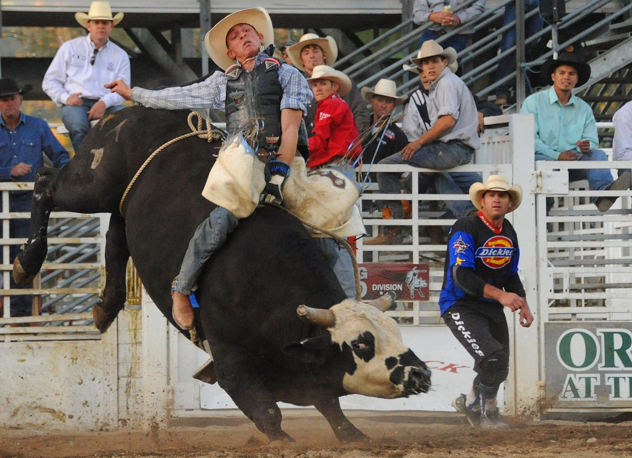 Dakota Beck rides Sunday in the Professional Bull Riding Rocky Mountain Bull Bash in downtown Steamboat Springs. Beck won the seventh annual event, pocketing a championship belt buckle and more than $5,000.