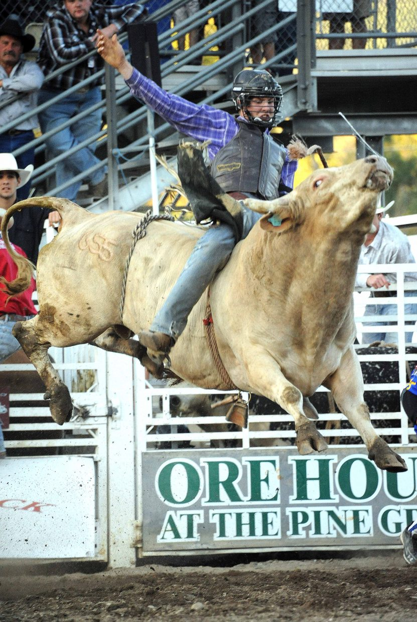 A cowboy rides Sunday at the PBR Rocky Mountain Bull Bash in Steamboat Springs.