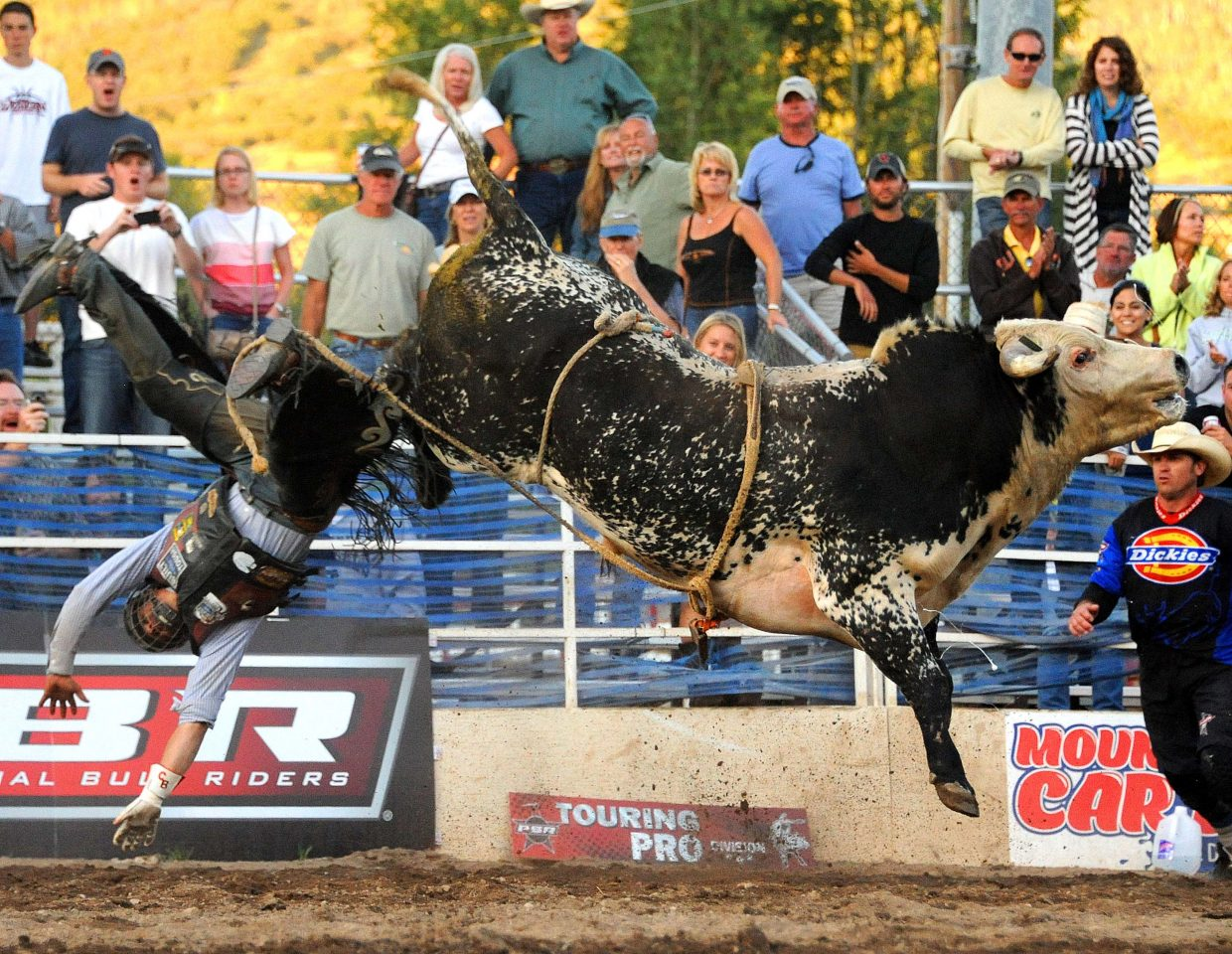 A cowboy flies off a bull Sunday at the Rocky Mountain Bull Bash in Steamboat Springs.