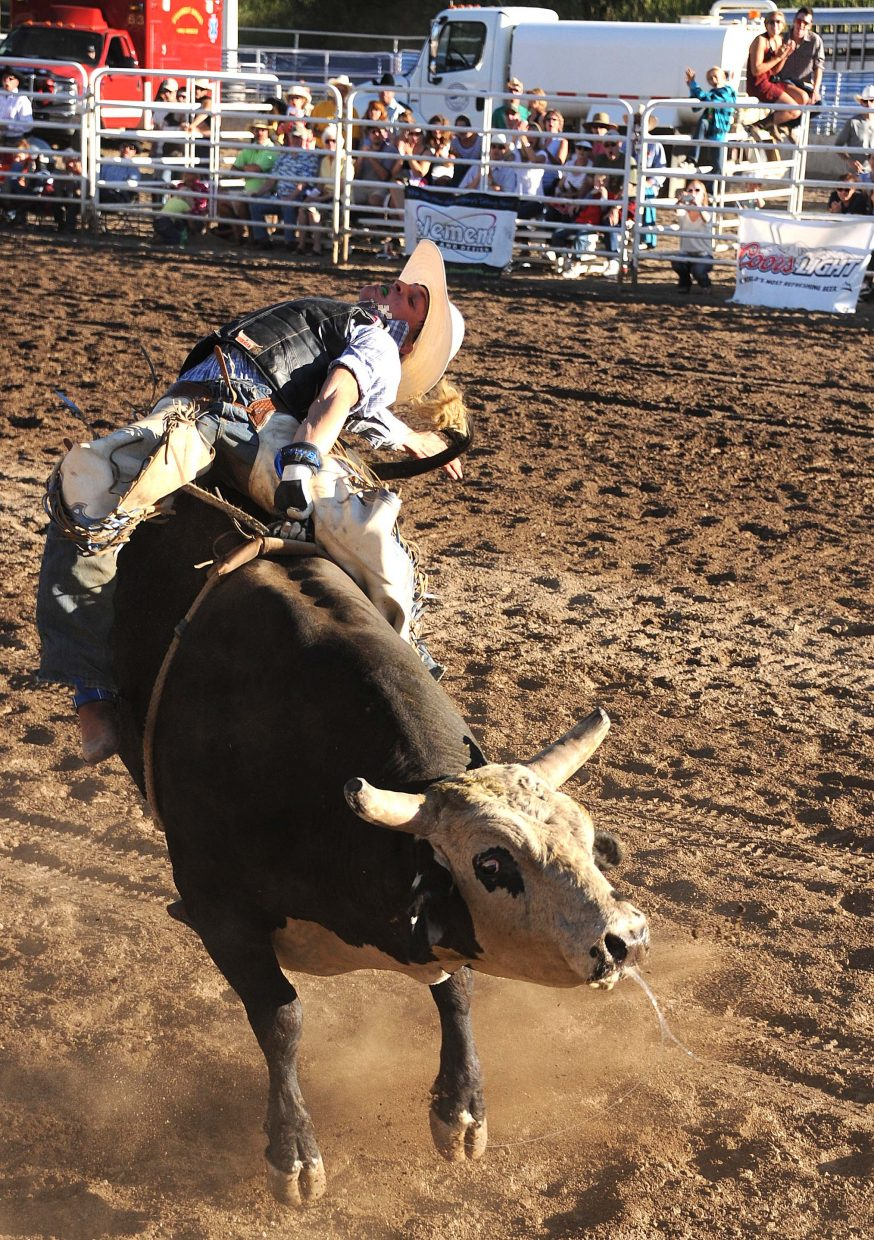 Dakota Beck rides Sunday in the PBR Rocky Mountain Bull Bash in downtown Steamboat Springs.