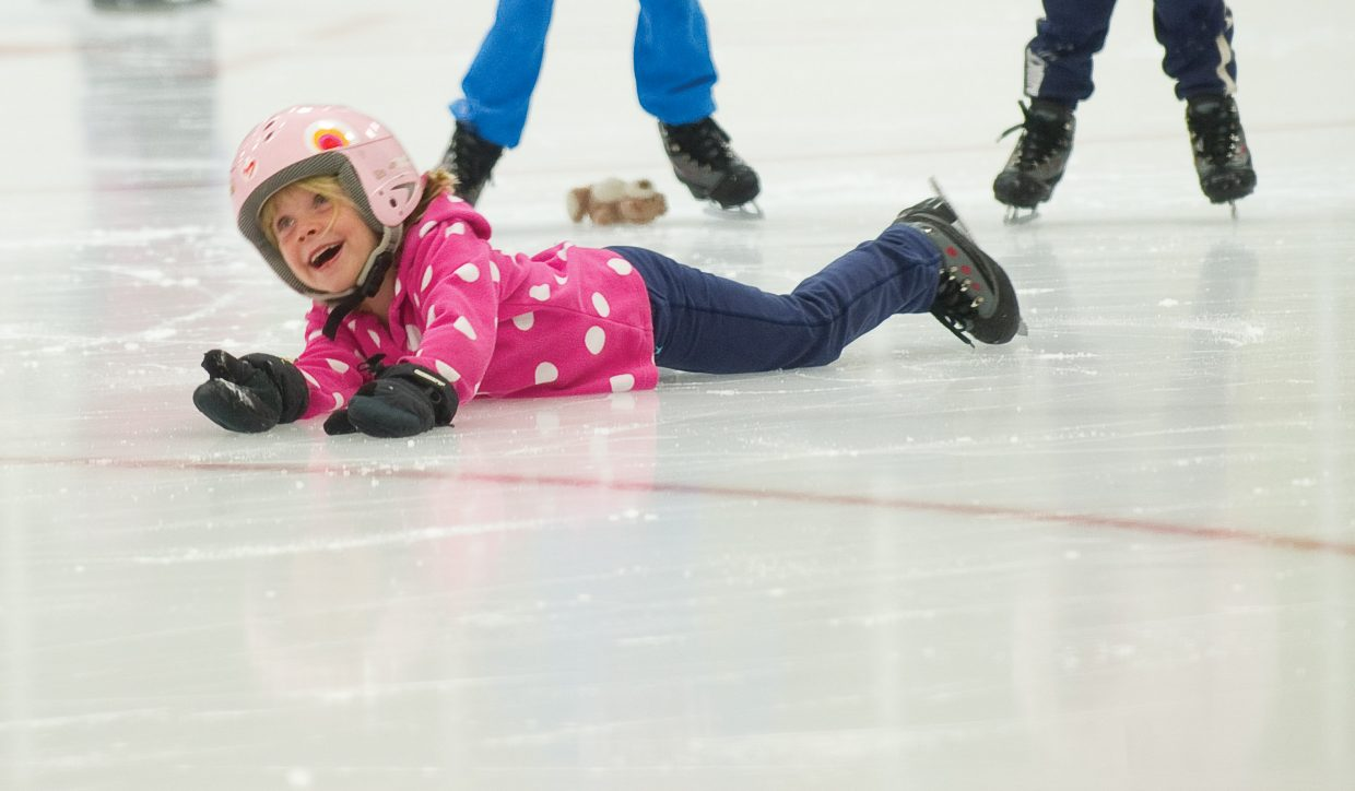 Ellie Mitchell laughs after sliding across the ice Wednesday as part of the Learn to Skate program at Howelsen Ice Arena.