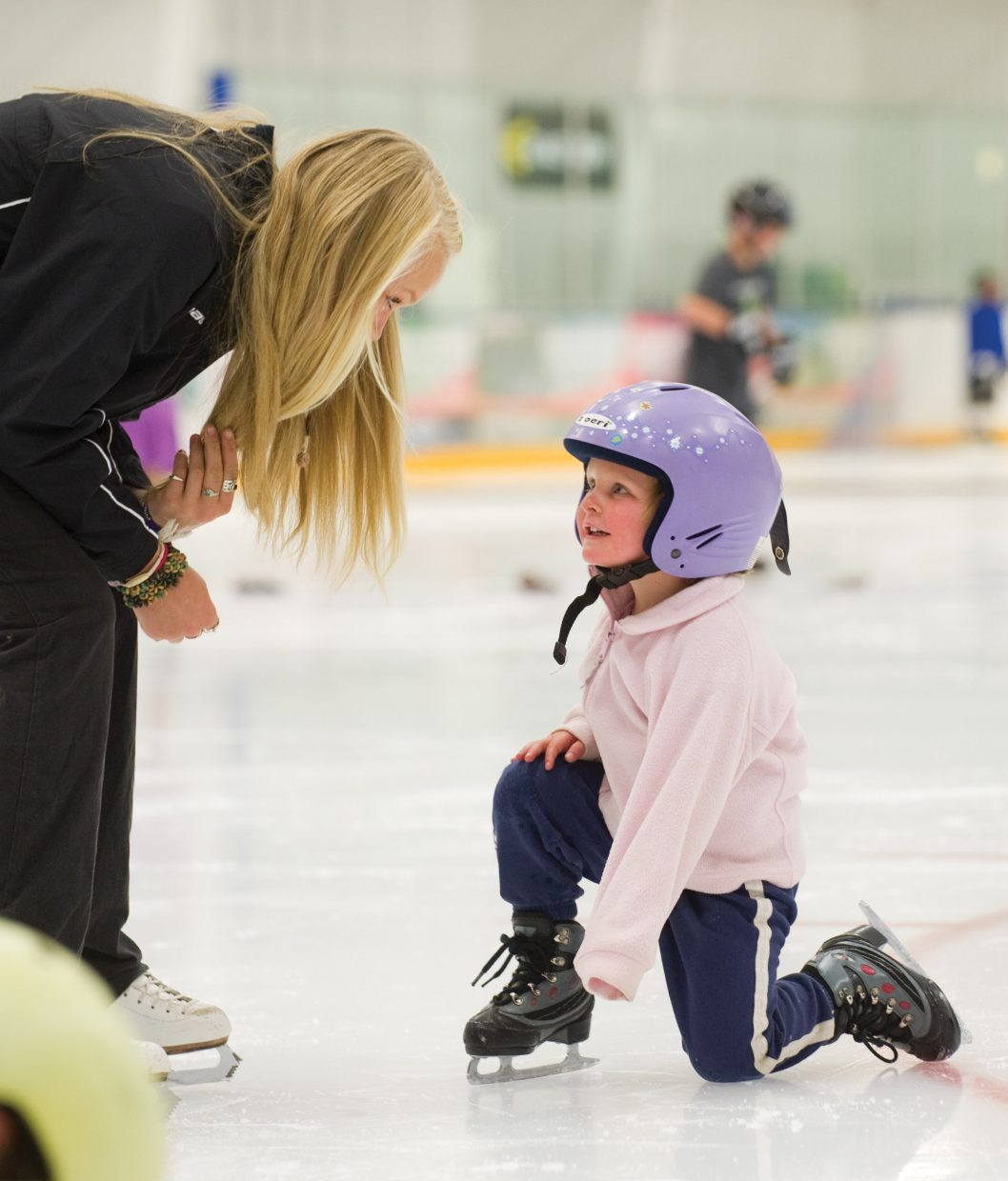 Shea Shorland listens to her instructor Samantha Cretney on Wednesday during the Learn to Skate program at Howelsen Ice Arena.
