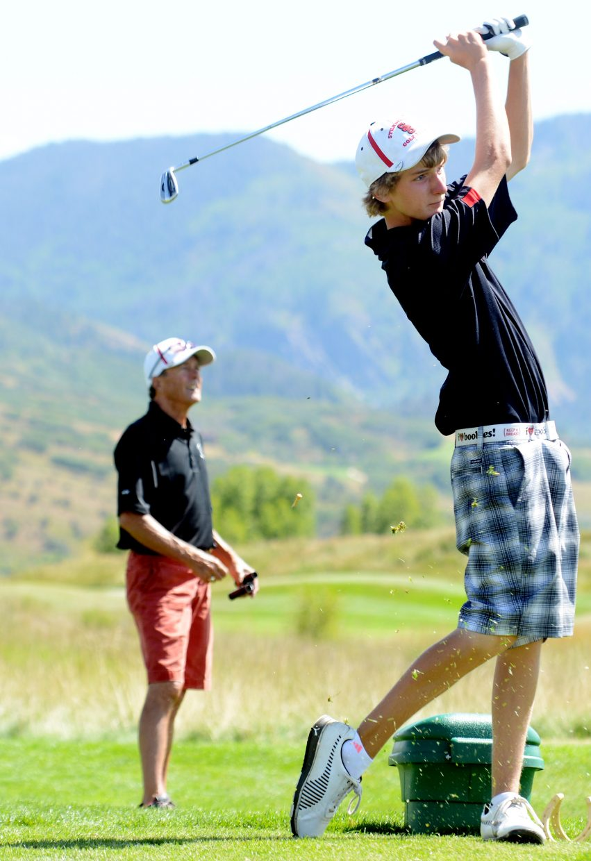 Steamboat coach Steve Dodson watches as Brandon Martin tees off Thursday at Haymaker Golf Course in Steamboat Springs.