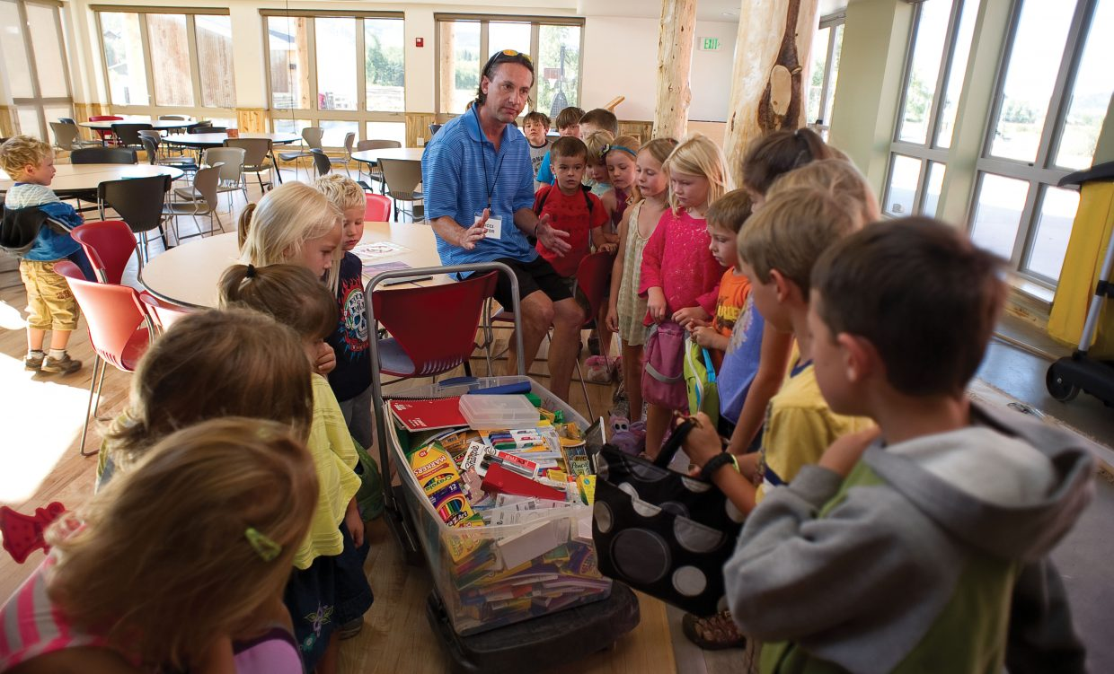 George Avgares, with Colorado Student Care, talks to kindergarten, first- and second-grade students while delivering a tub filled with school supplies to the North Routt Community Charter School on Thursday.