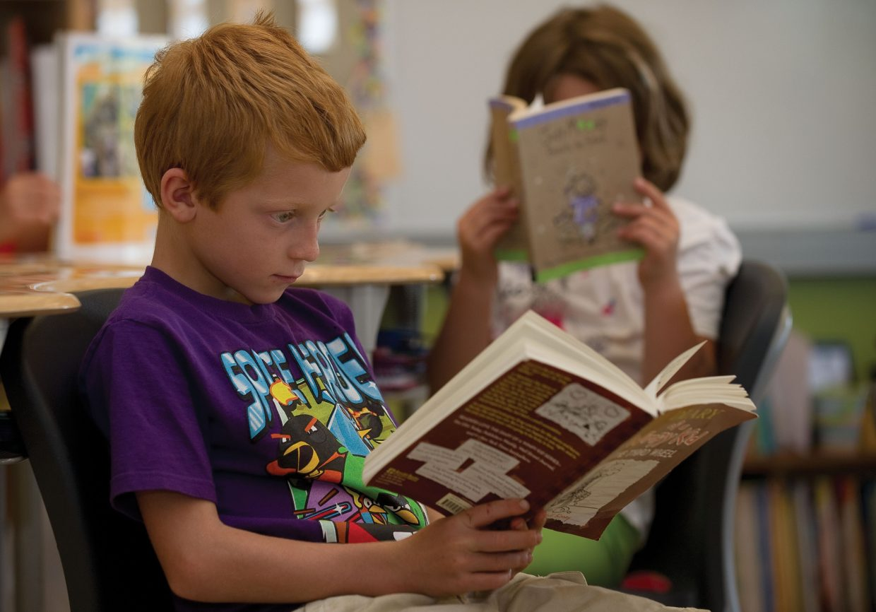 Zakkary Leftwich, a student at the North Routt Community Charter School, reads a book in class earlier this week. The school started its new school year with Brandon LaChance as director.