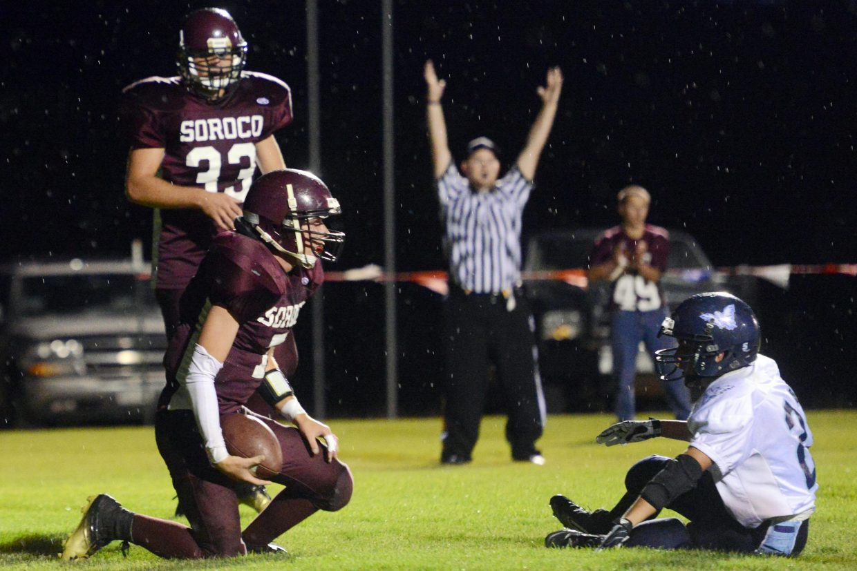 Matt Regan stands up after scoring a two-point conversion Friday against Justice.