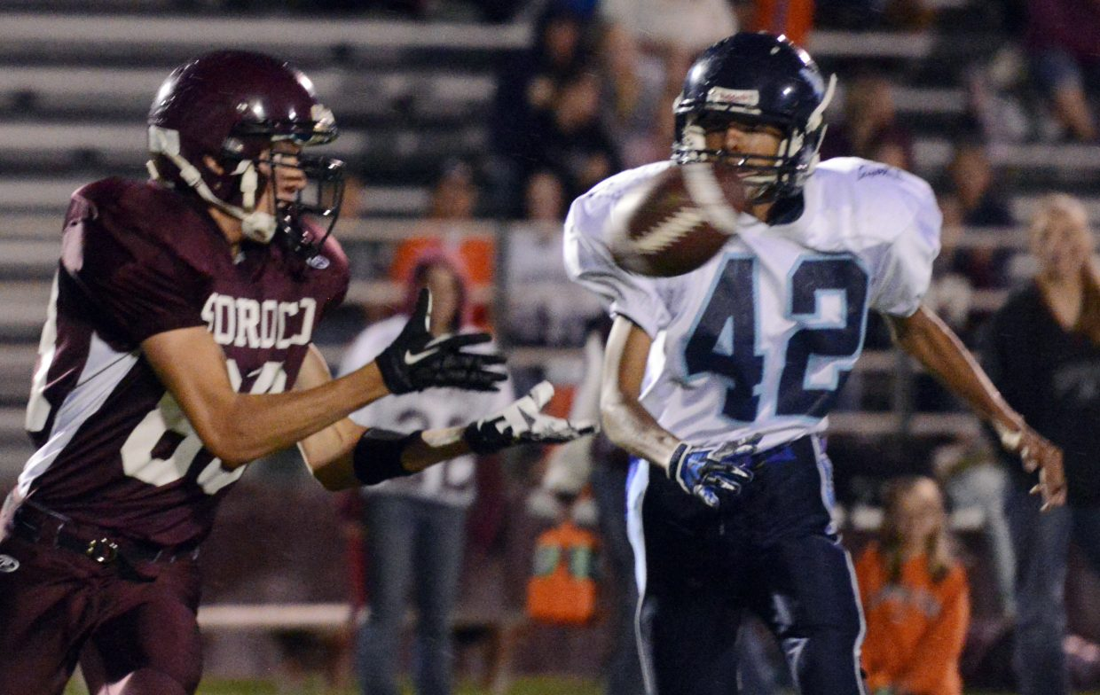 Bjorn Carlson hauls in a pass Friday against Justice. Soroco's offense had no problems in the rout.