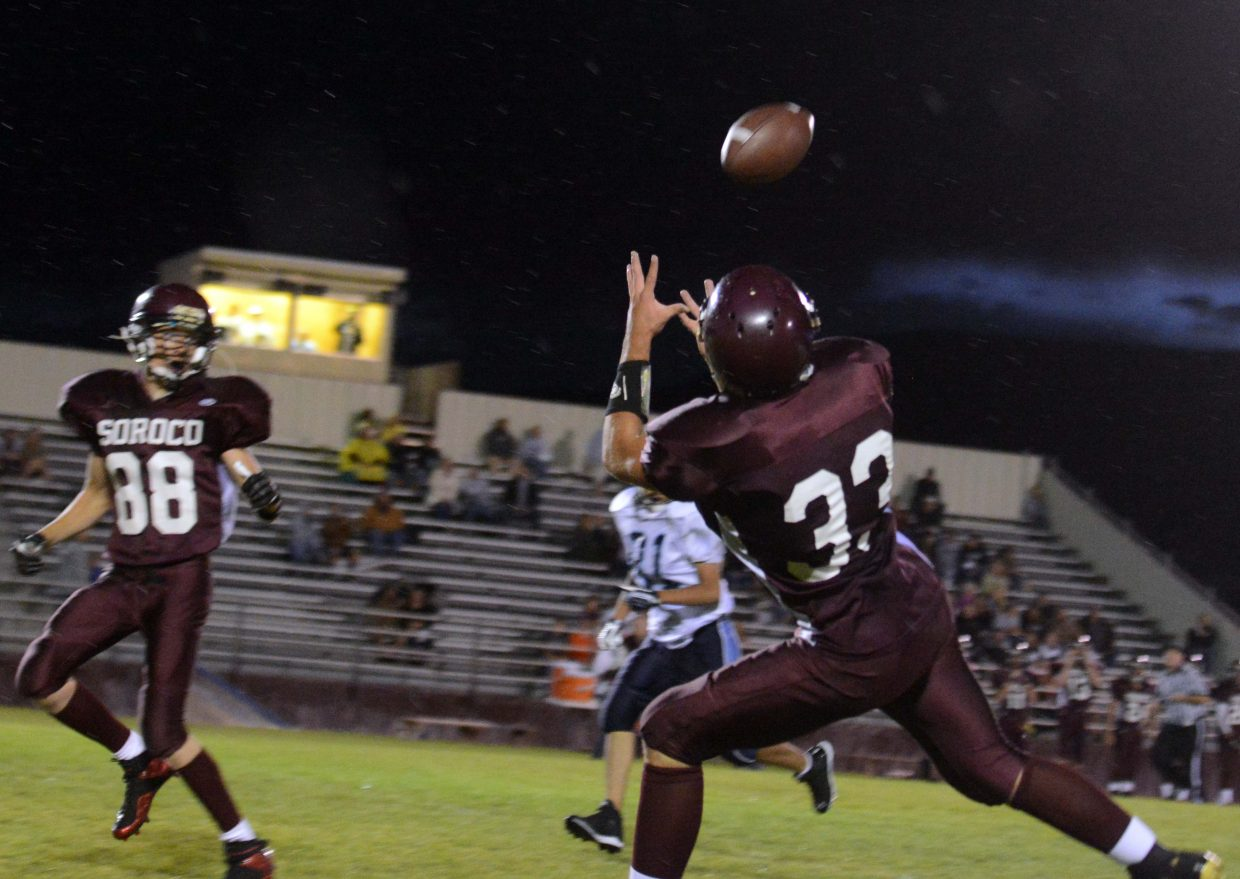 Ryan Jeep, No. 33, eyes the ball for a big catch and a long gain Friday against Justice.