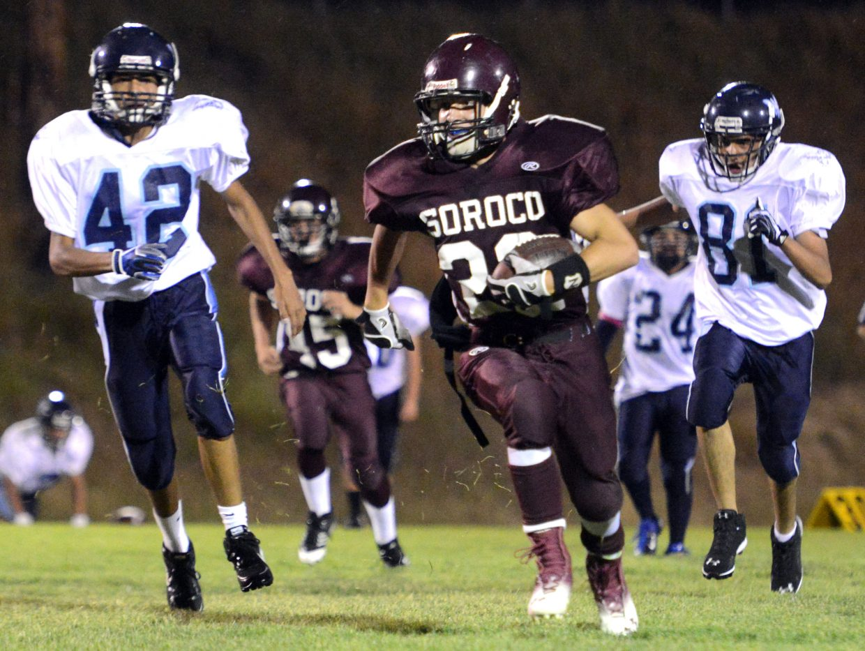 Storm Veilleux sprints for a touchdown on a punt return Friday against Justice. The sophomore scored five touchdowns in the game en route to Soroco High School's 54-6 victory.