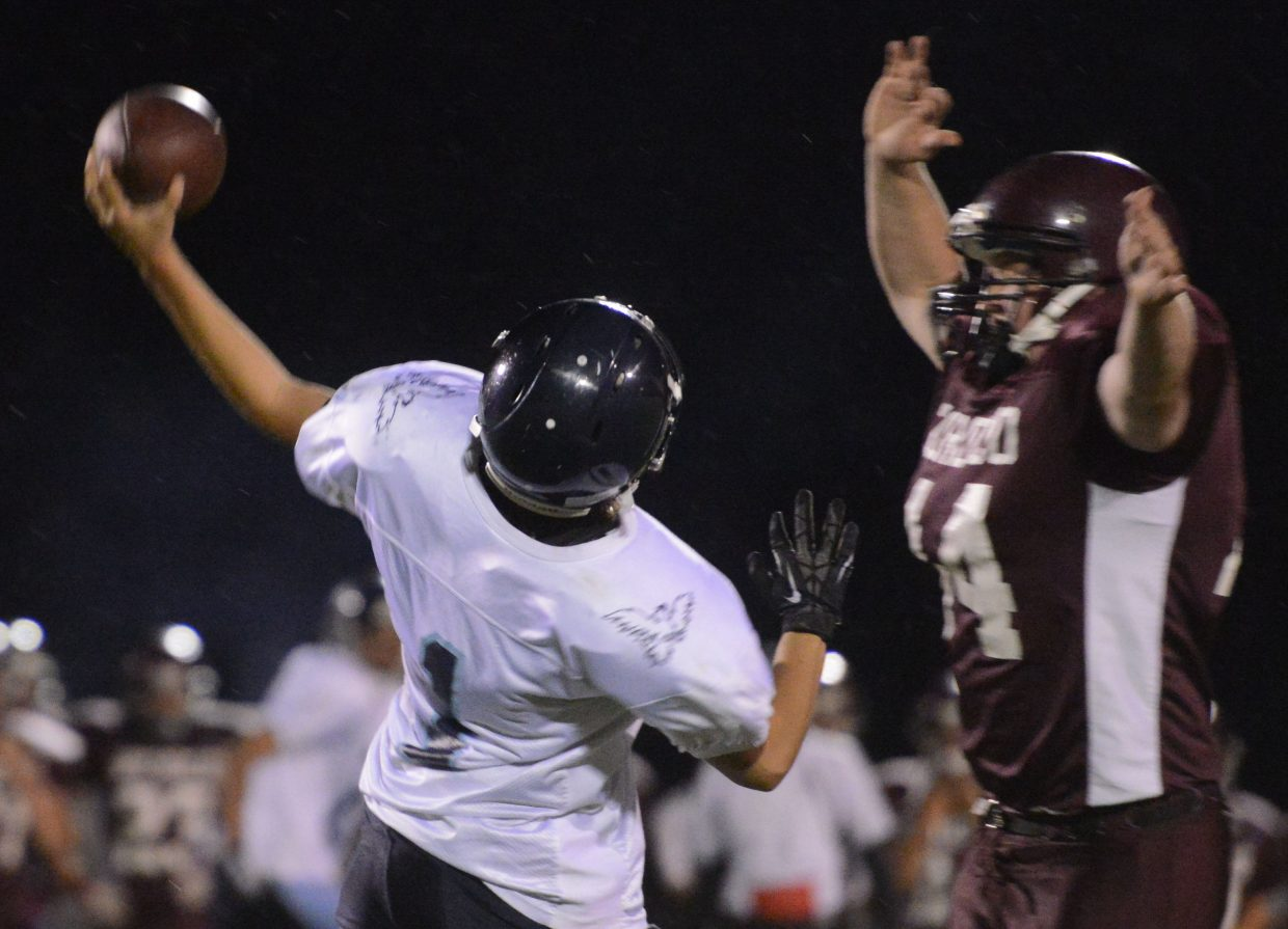 Soroco's Ian Palyo leaps to block a pass Friday against Justice. He missed, but teammate Storm Veilleux picked the pass off and returned it for a touchdown.