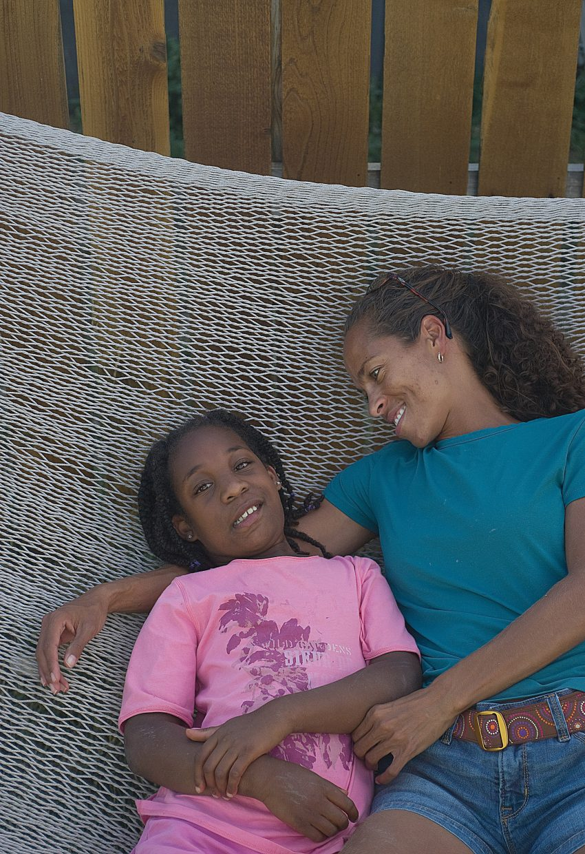 Kia Smith and her 9-year-old daughter Nevaeh hang out at their Steamboat Springs home.