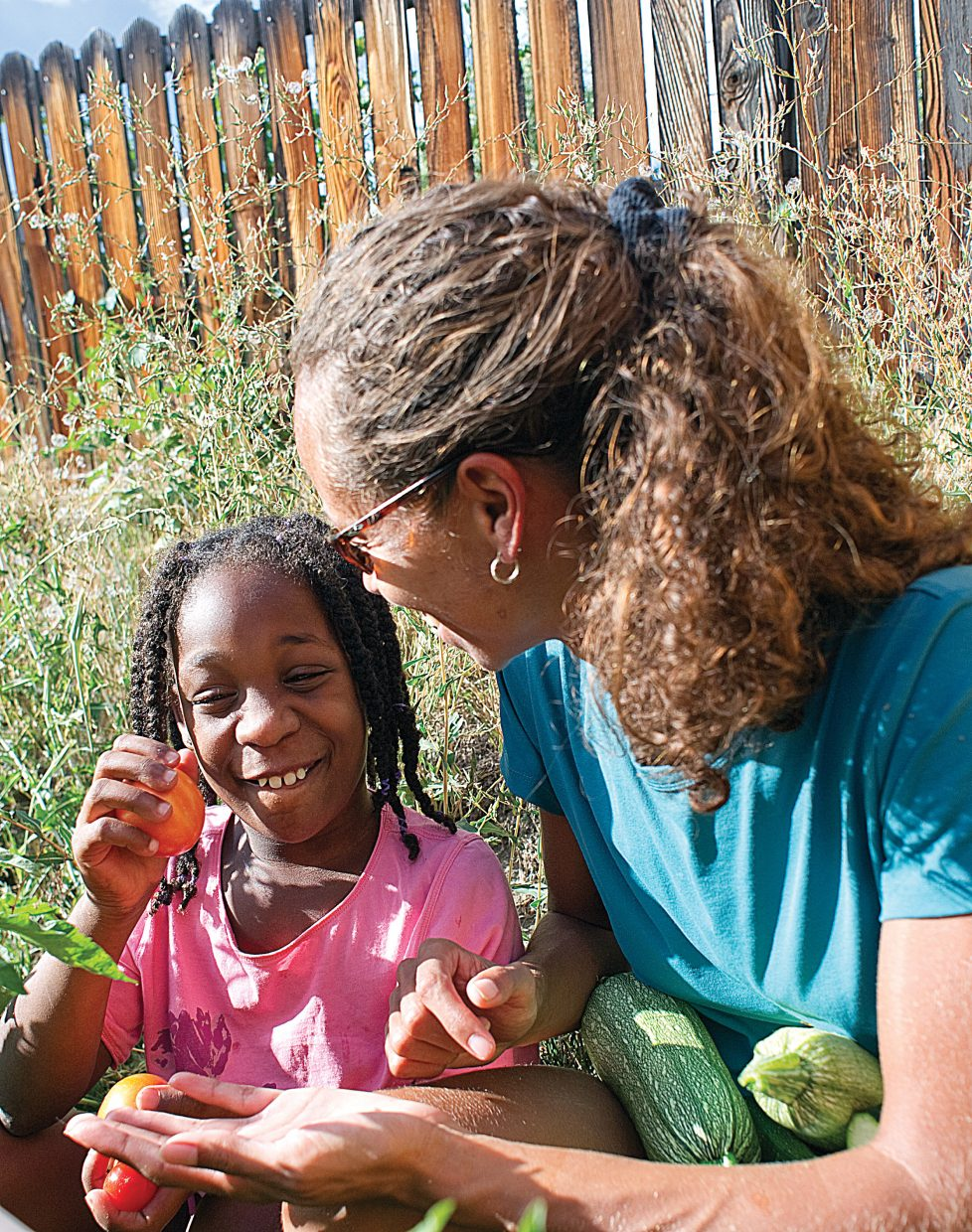 Kia Smith and her 9-year-old daughter Nevaeh work in the garden at their Steamboat Springs home.