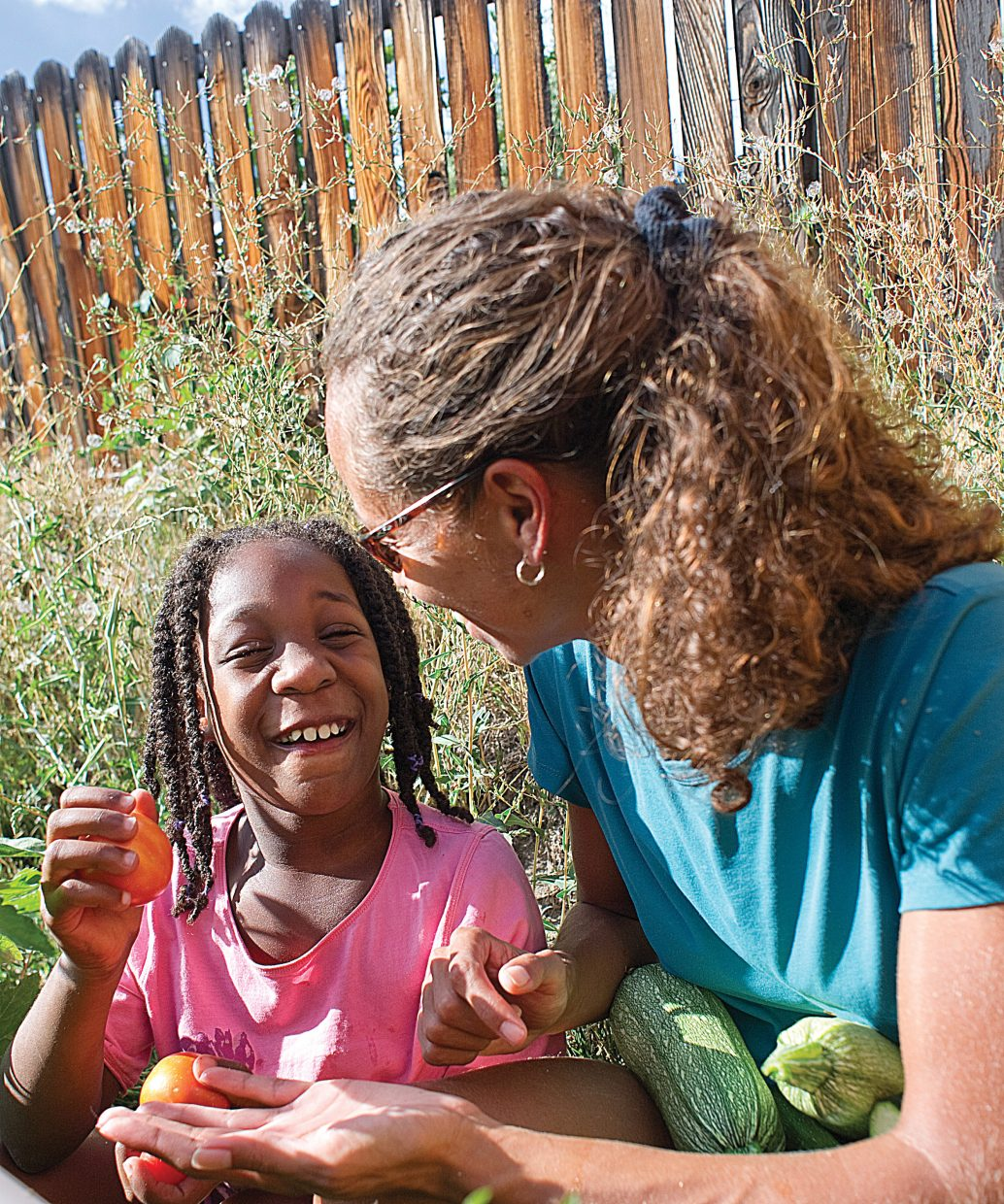 Kia Smith and her 9-year-old daughter Nevaeh work in the garden of their Steamboat Springs home.