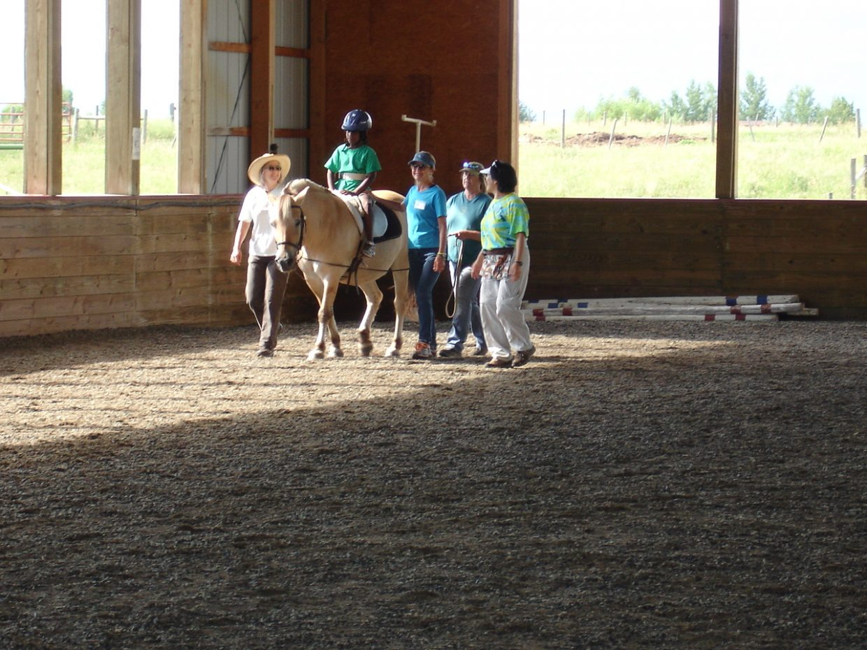 Neveah Smith rides Frejha, the therapy horse she works with at Humbe Ranch Education and Therapy Center.