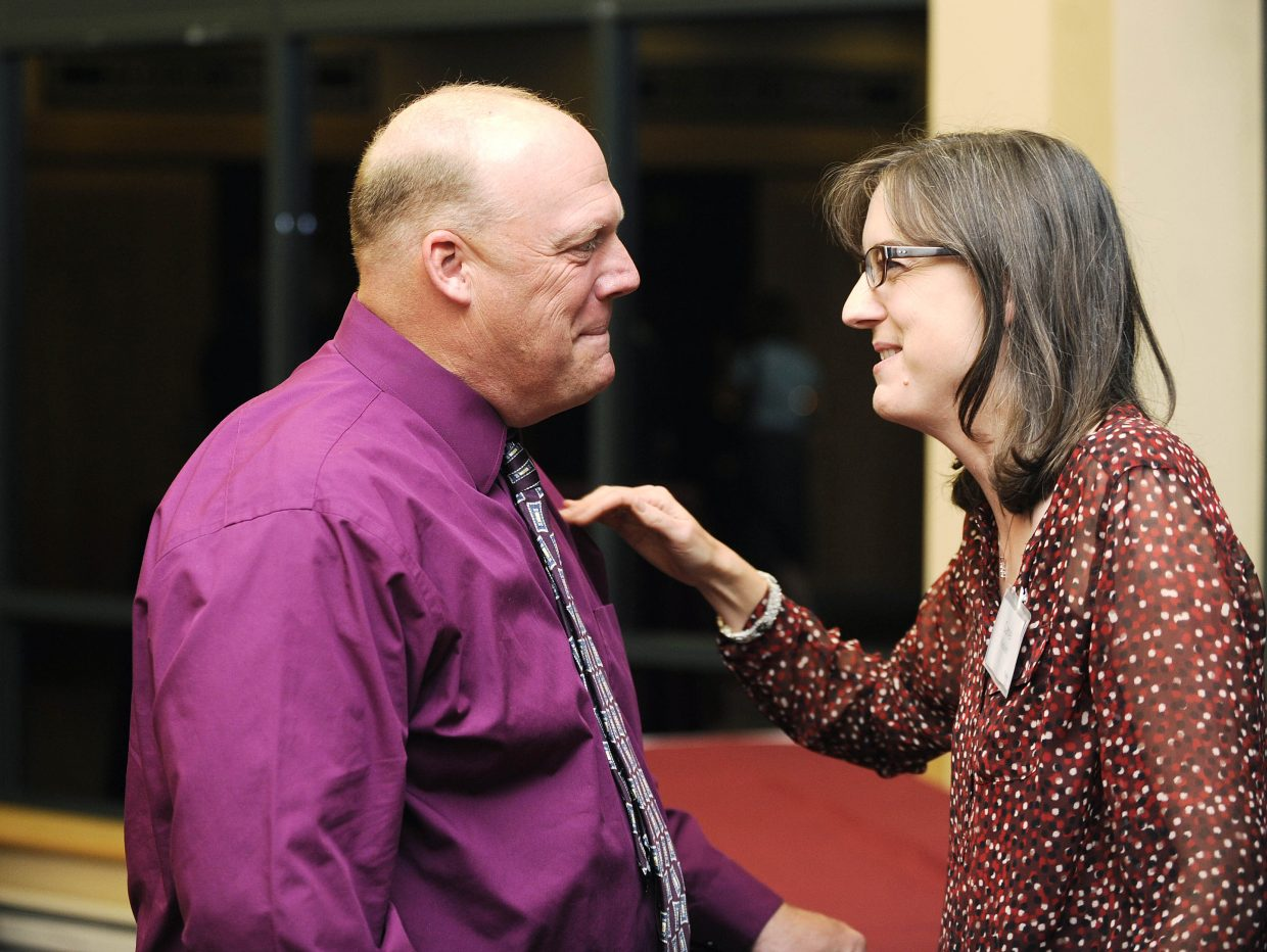 Hayden High School welding and automotive instructor Kevin Kleckler is congratulated by his wife, Carrie, after he was named the Educator of the Year during a dinner Saturday at The Steamboat Grand.