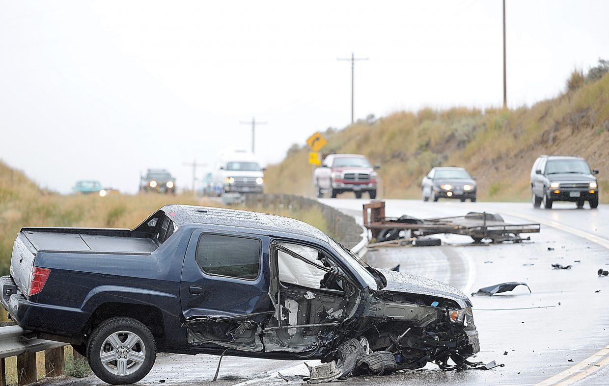 A Honda Ridgeline rests on a guardrail in the eastbound lane of U.S. Highway 40 just outside of Milner on Monday morning. The driver was headed east when the vehicle drifted into the oncoming traffic lane and was sideswiped by a Ford F150 driven by Randall Ford. Ford said he attempted to avoid the collision by driving in the other lane, but caught the side of the Ridgeline with the side of his vehicle and the trailer he was pulling. The driver of the Honda was transported to Yampa Valley Medical Center and released. There were no other injuries. The state patrol still is investigating the accident, and would not release the name of the driver of the Honda at this point in time.
