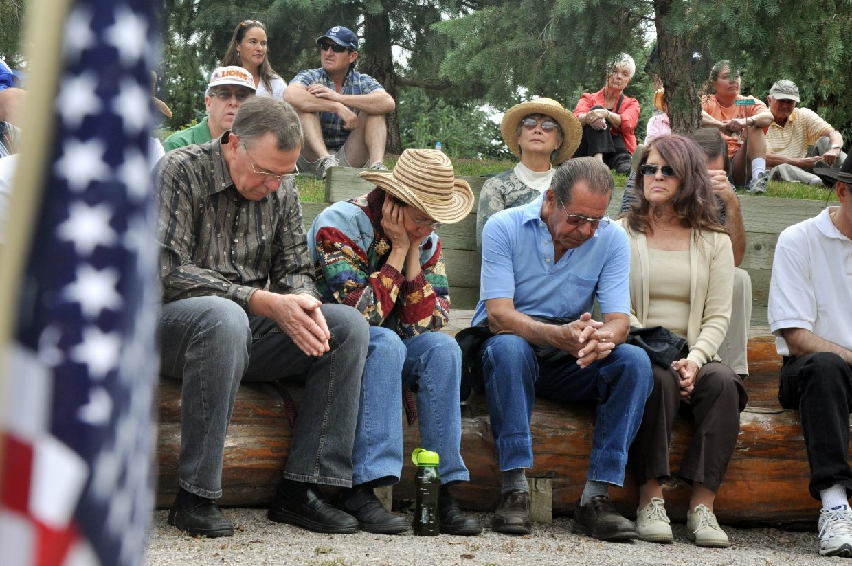 From left, Dave and Cheryl Kutscher and Ron and Kathie Pearl pray Sunday during a gathering at the Yampa River Botanic Park in remembrance of the Sept. 11, 2001, terrorist attacks.