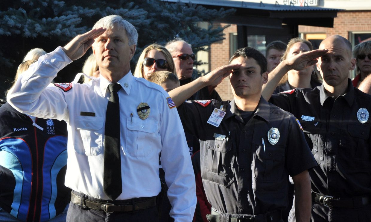 Steamboat Springs Fire Rescue Chief Ron Lindroth, left, salutes an American flag Sept. 11, 2011, during an event at the Routt County Courthouse commemorating the 10th anniversary of the 9/11 terrorist attacks. Lindroth is a finalist for a fire chief position with the Central Valley Fire District in Belgrade, Mont.