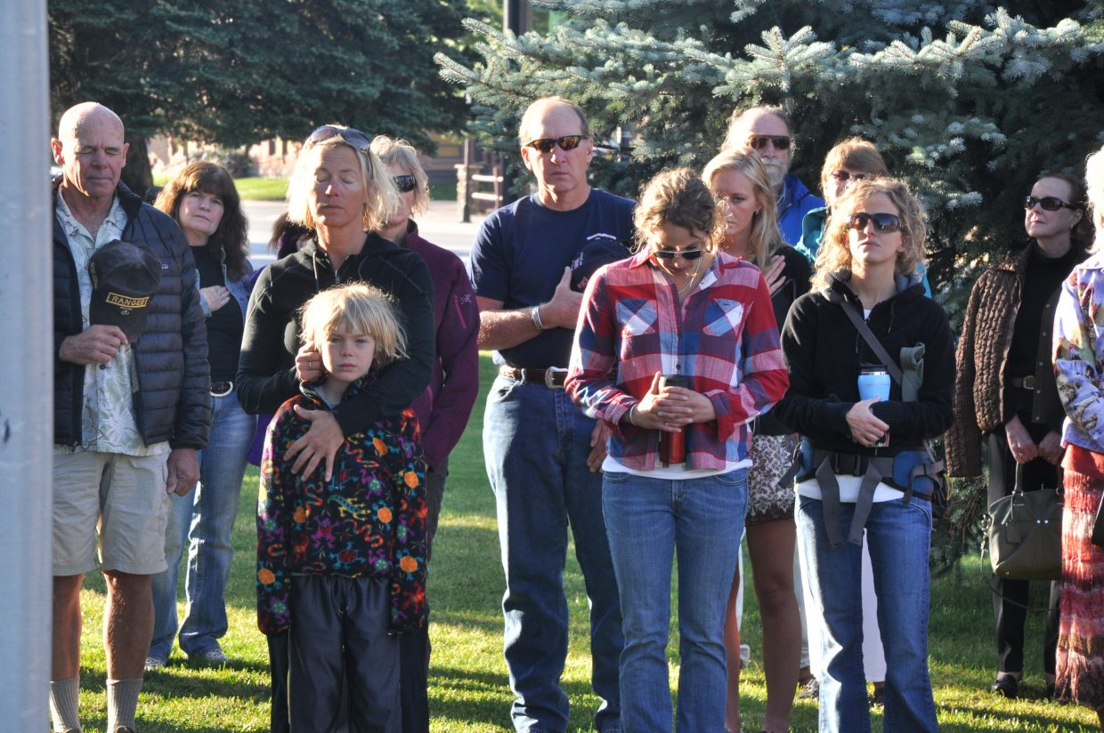 Steamboat Springs community members observe a moment of silence Sunday during a service to commemorate the Sept. 11, 2001, terrorist attacks.